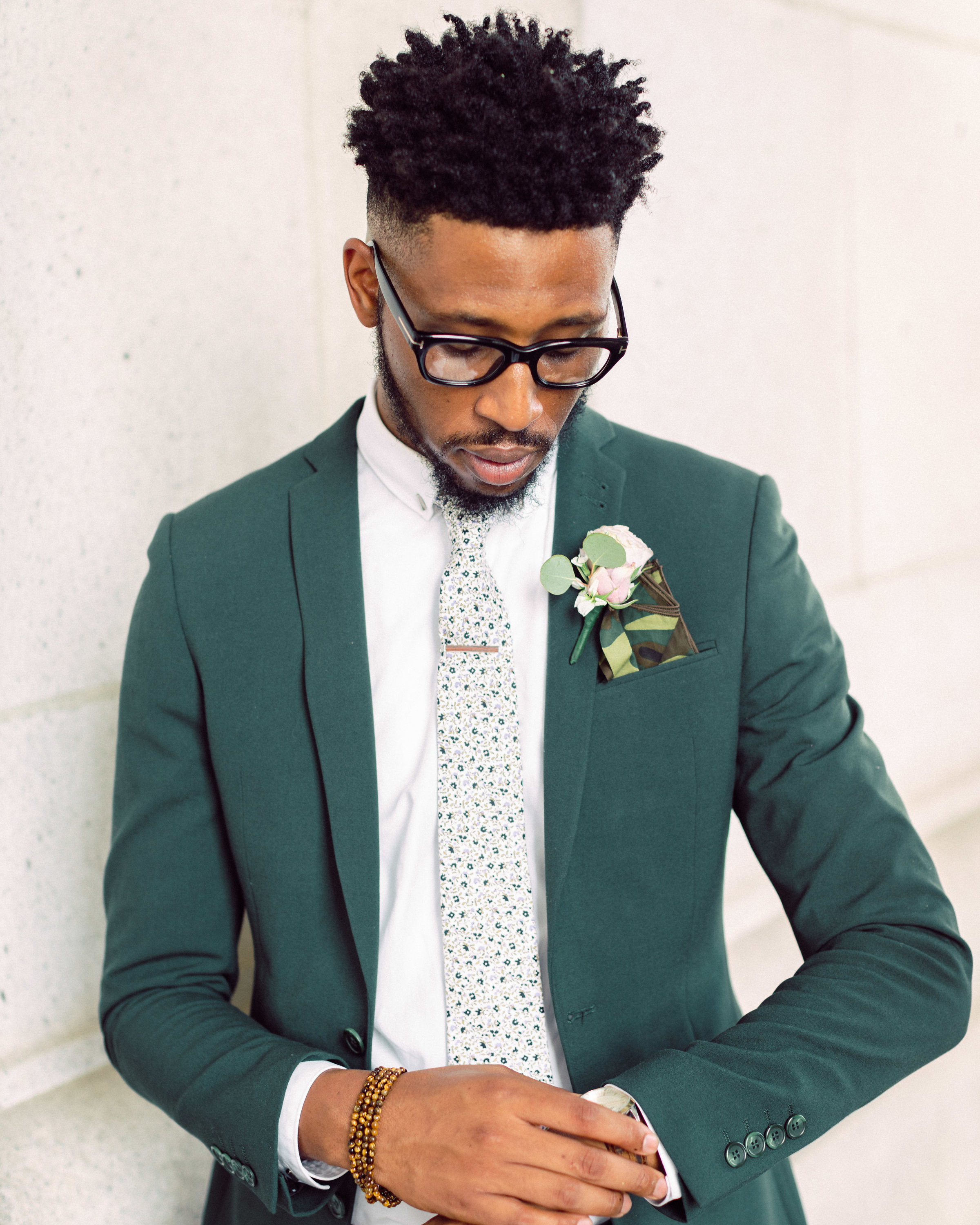 green ASOS suit with camo patterned pocket square