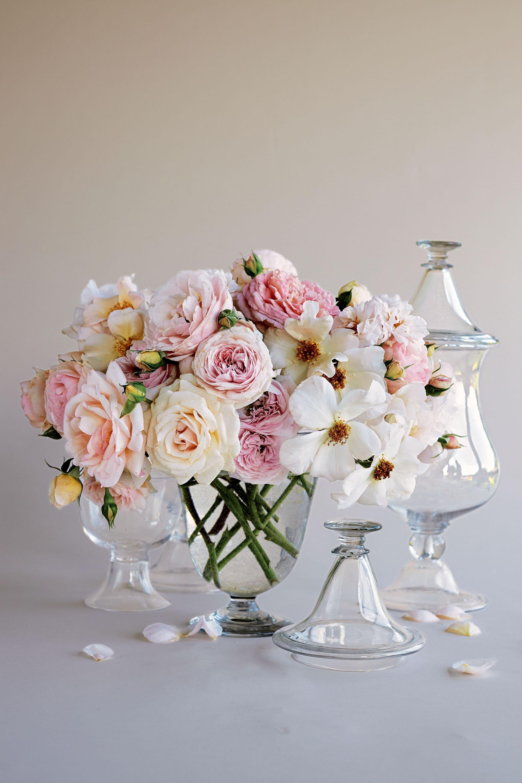 flower arrangement roses in jars