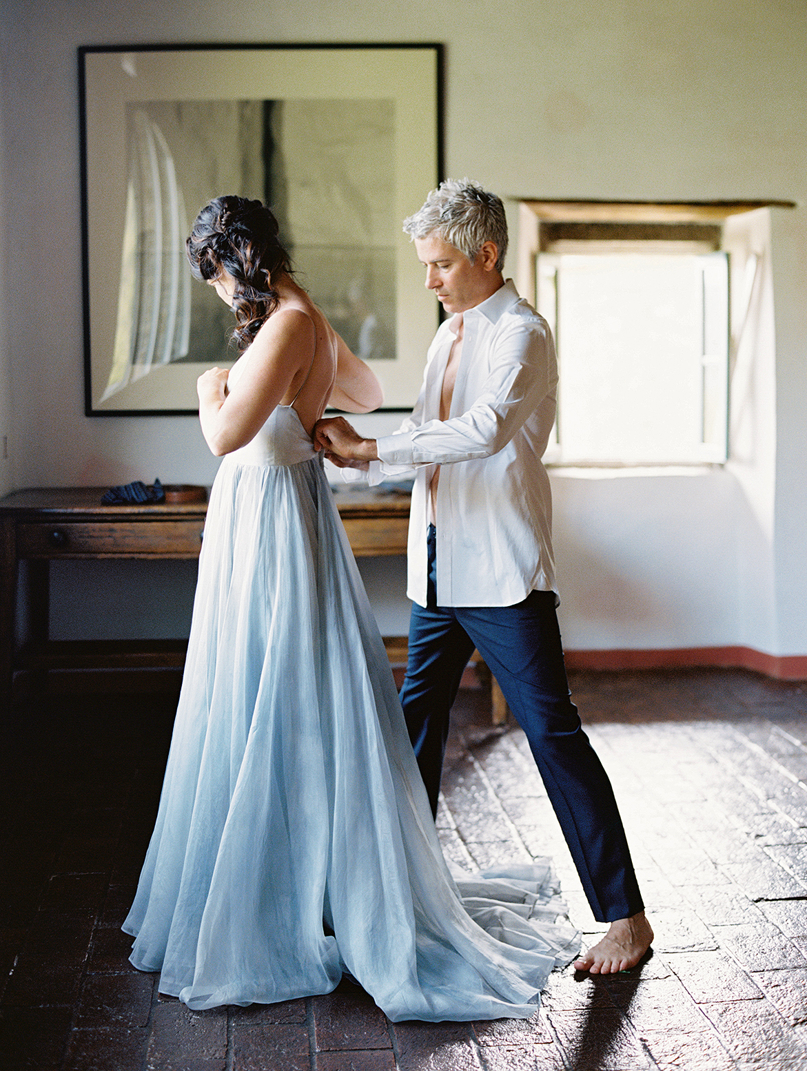kelly pete wedding groom helping bride with dress