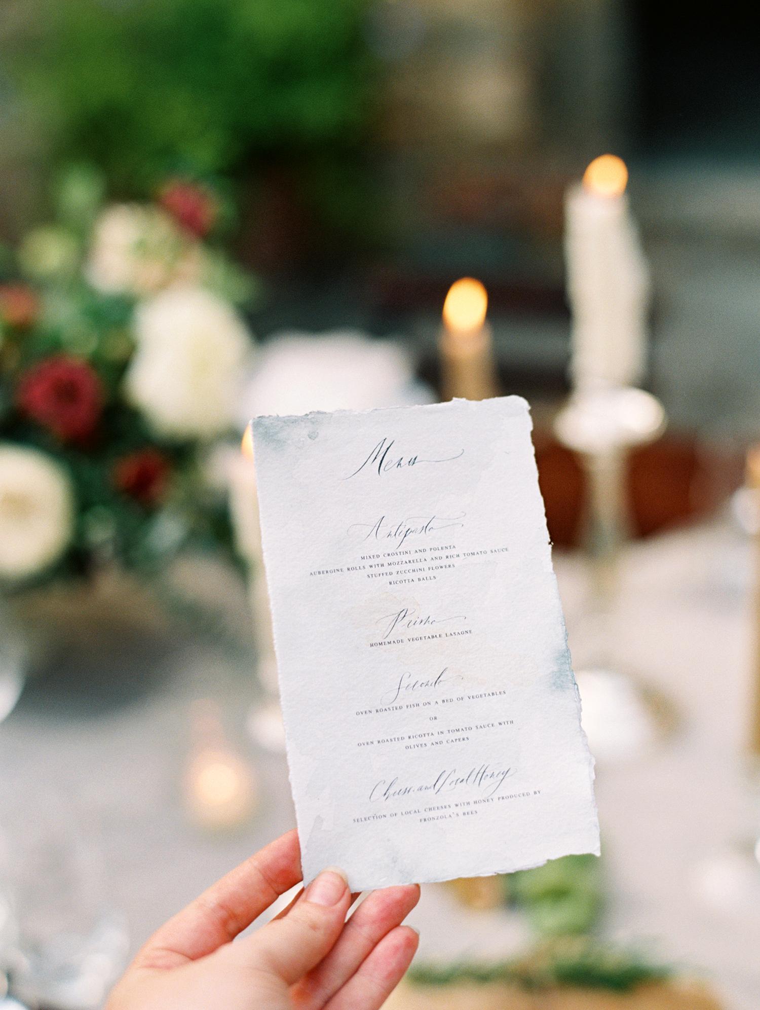 kelly pete wedding hand holding menu