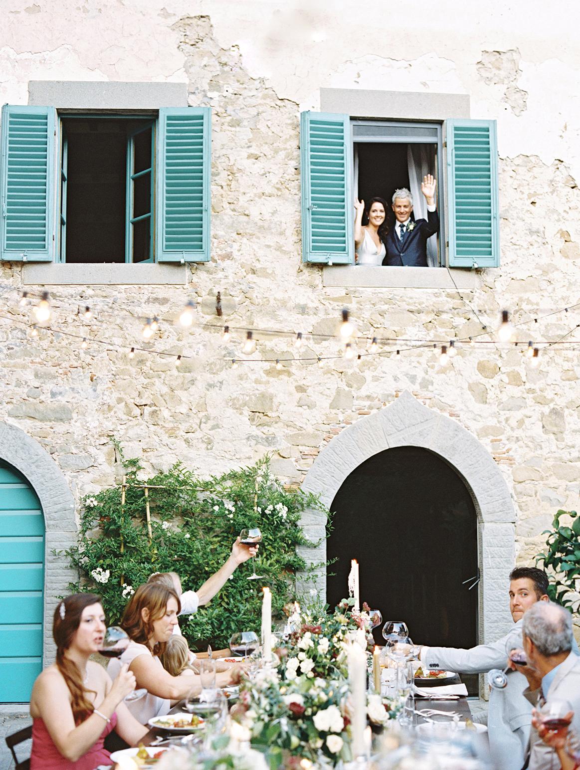 kelly pete wedding couple waving from window