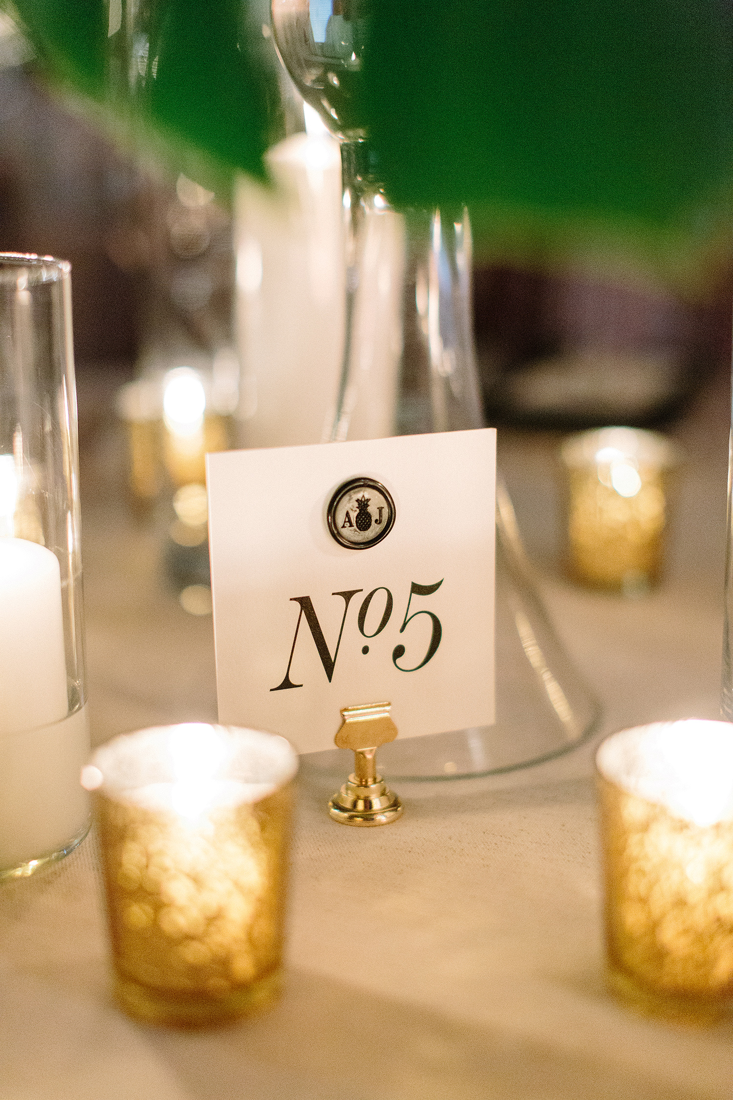 abbey jeffrey wedding table number with candles