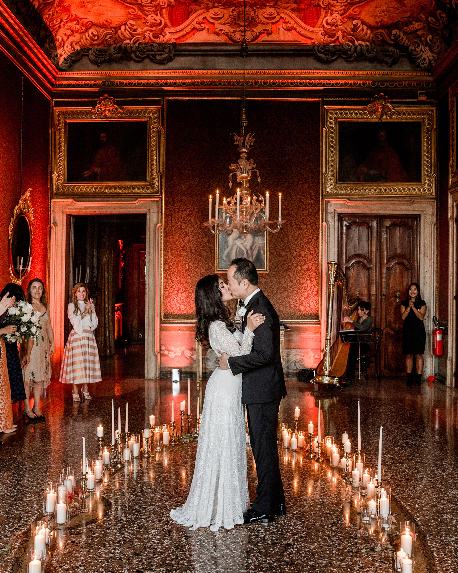 elle raymond venice wedding candlelit ceremony kiss
