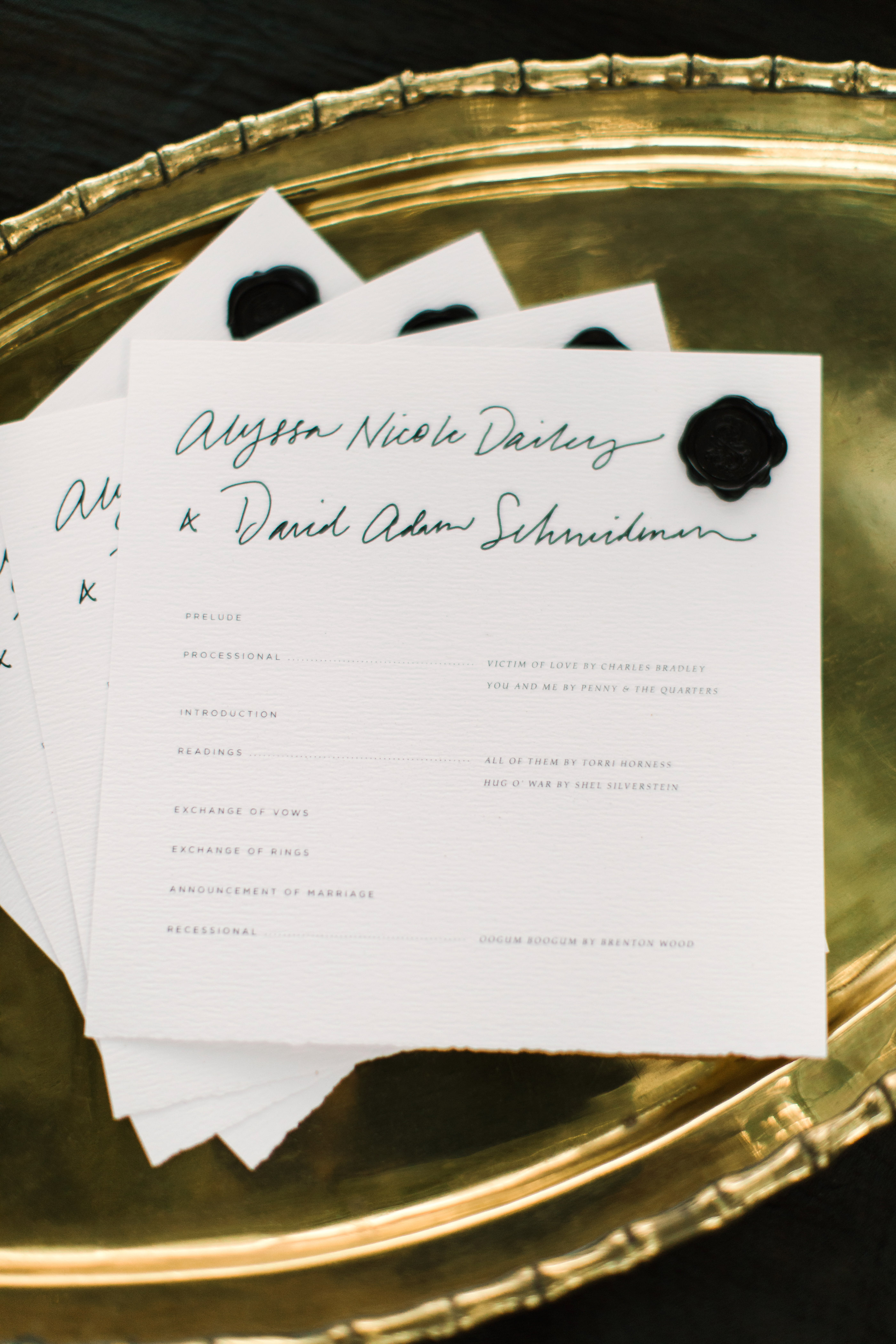 wedding programs on gold tray