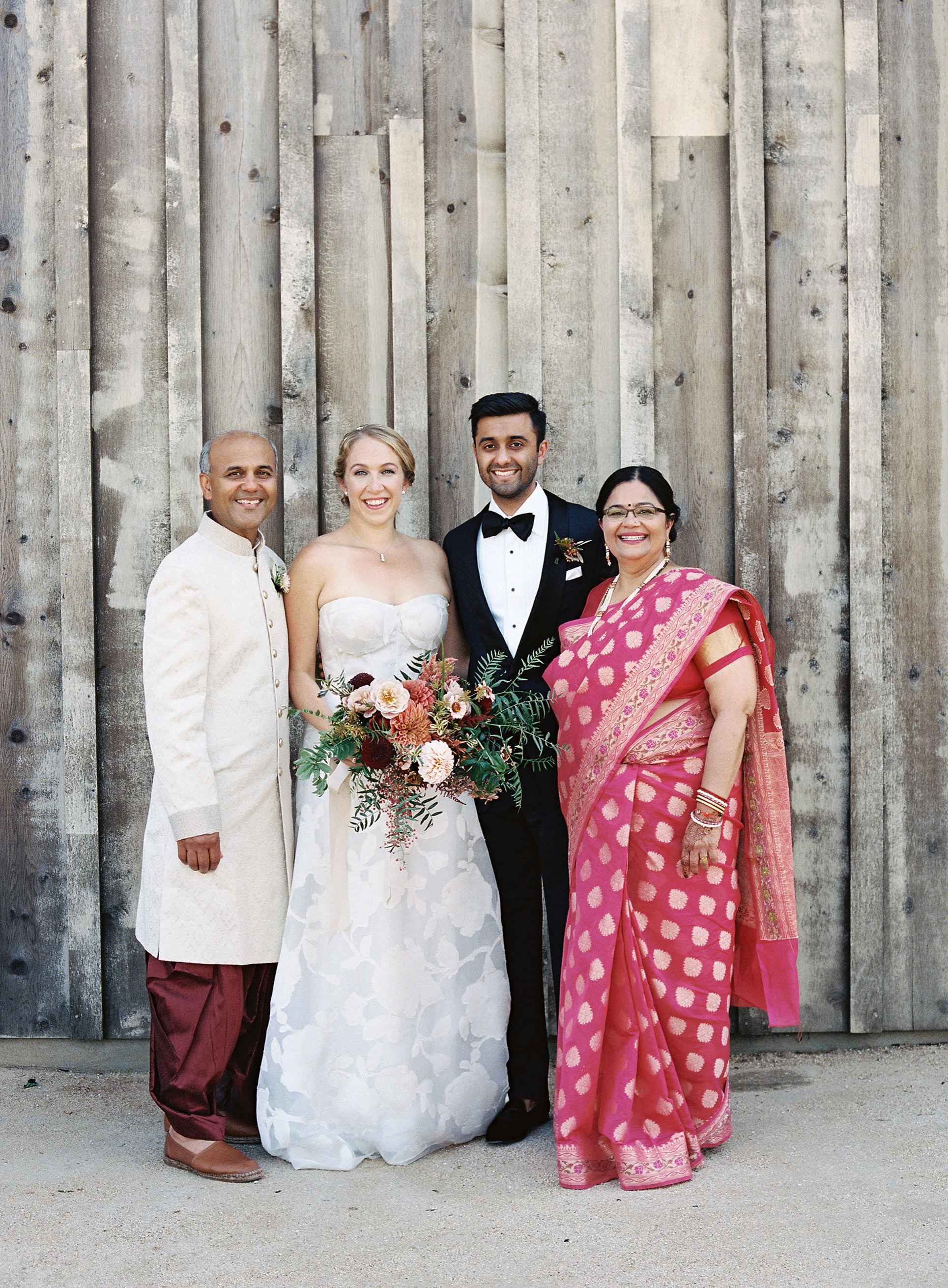 emily siddartha wedding parents outside
