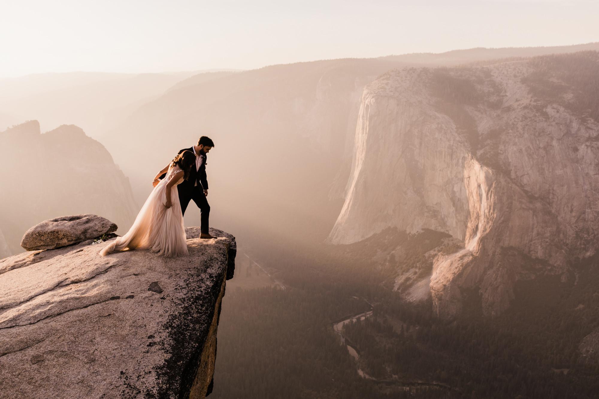 epic wedding photos abbi hearne couple on cliff