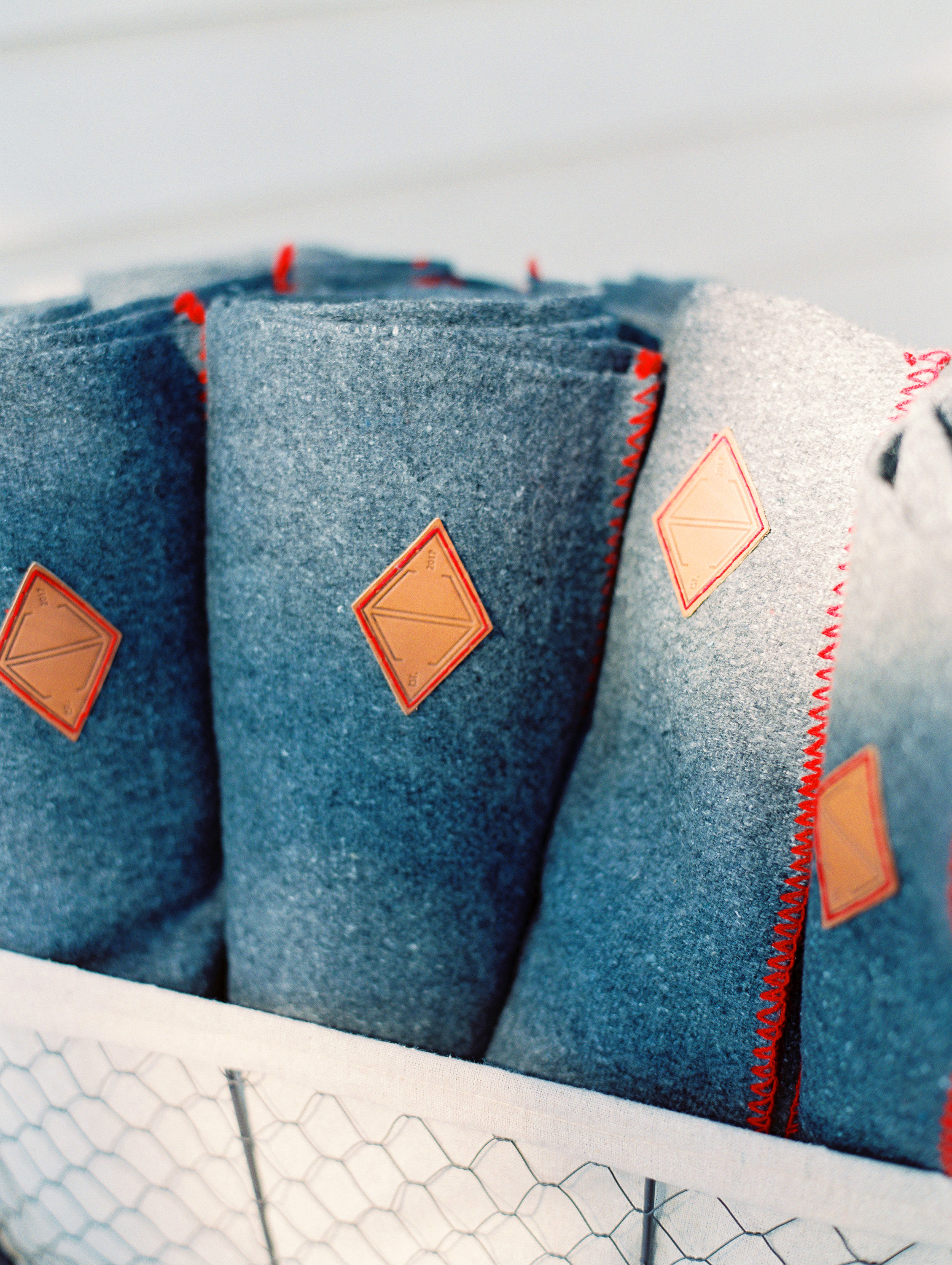 rob franco wedding blue blankets with red stitching