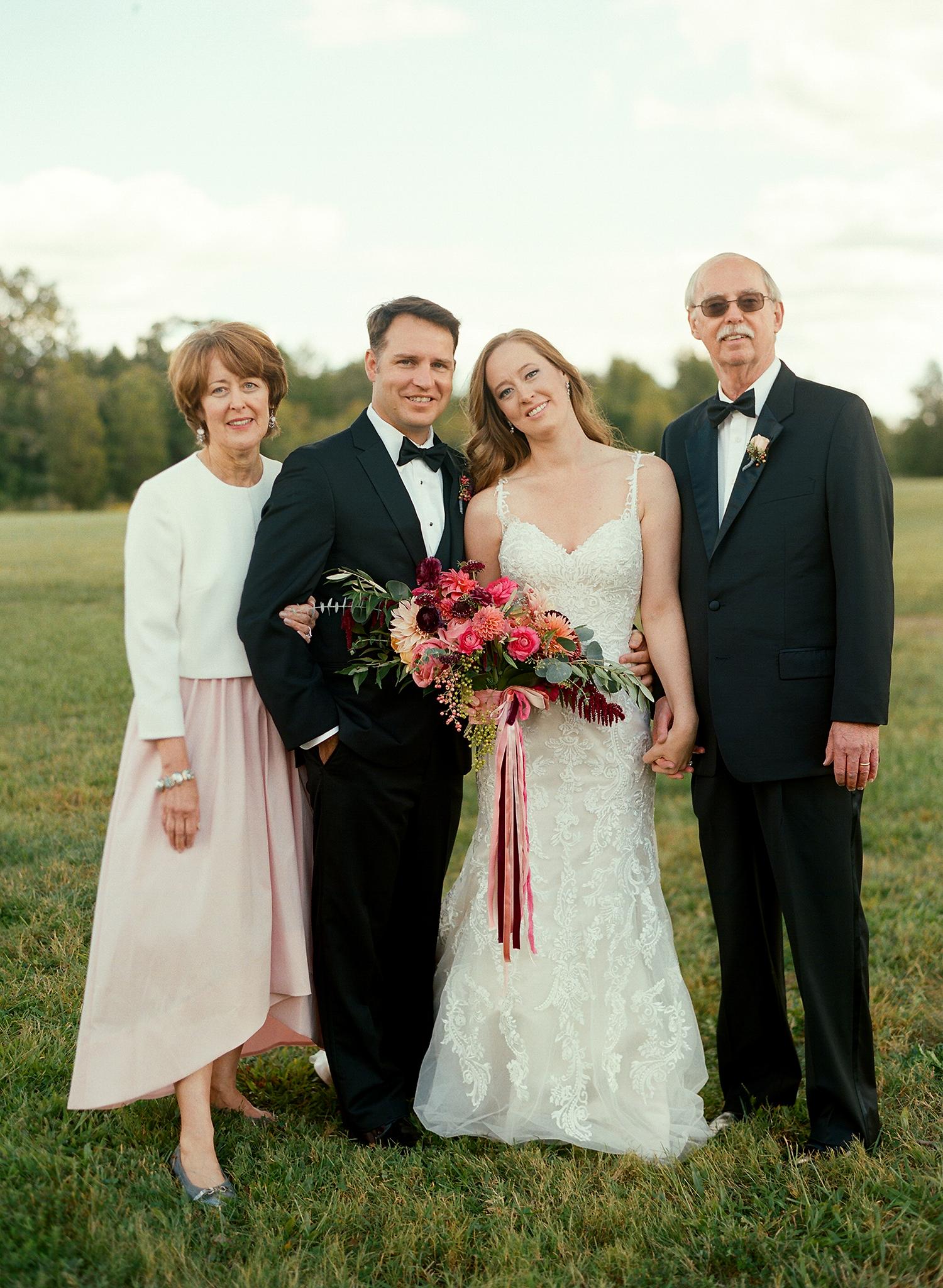 jen geoff wedding couple with parents