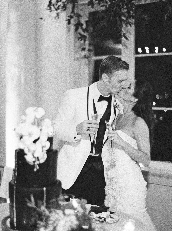 kate austin wedding cake cutting kiss bw