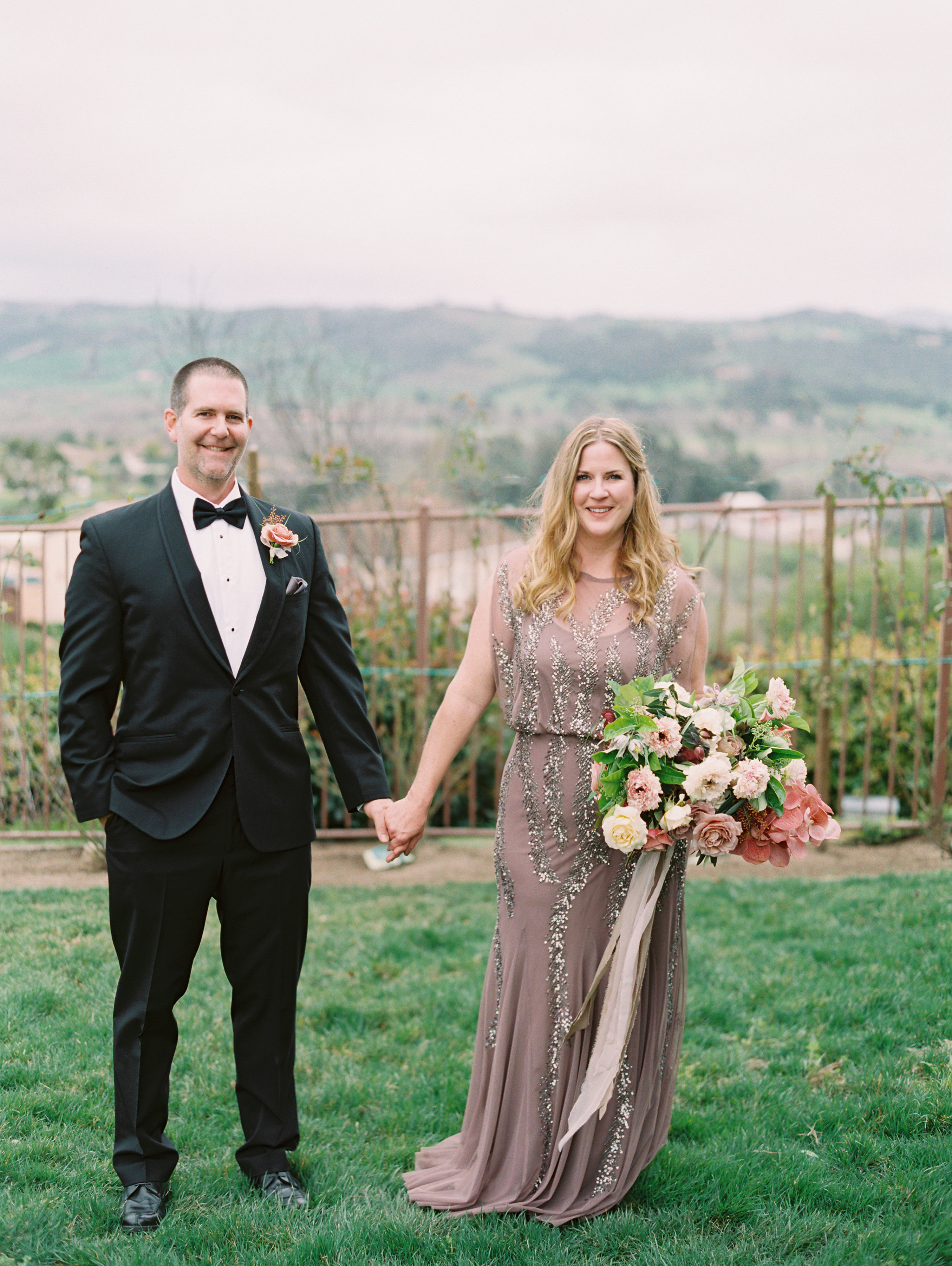surprise wedding couple holding hands valley overlook