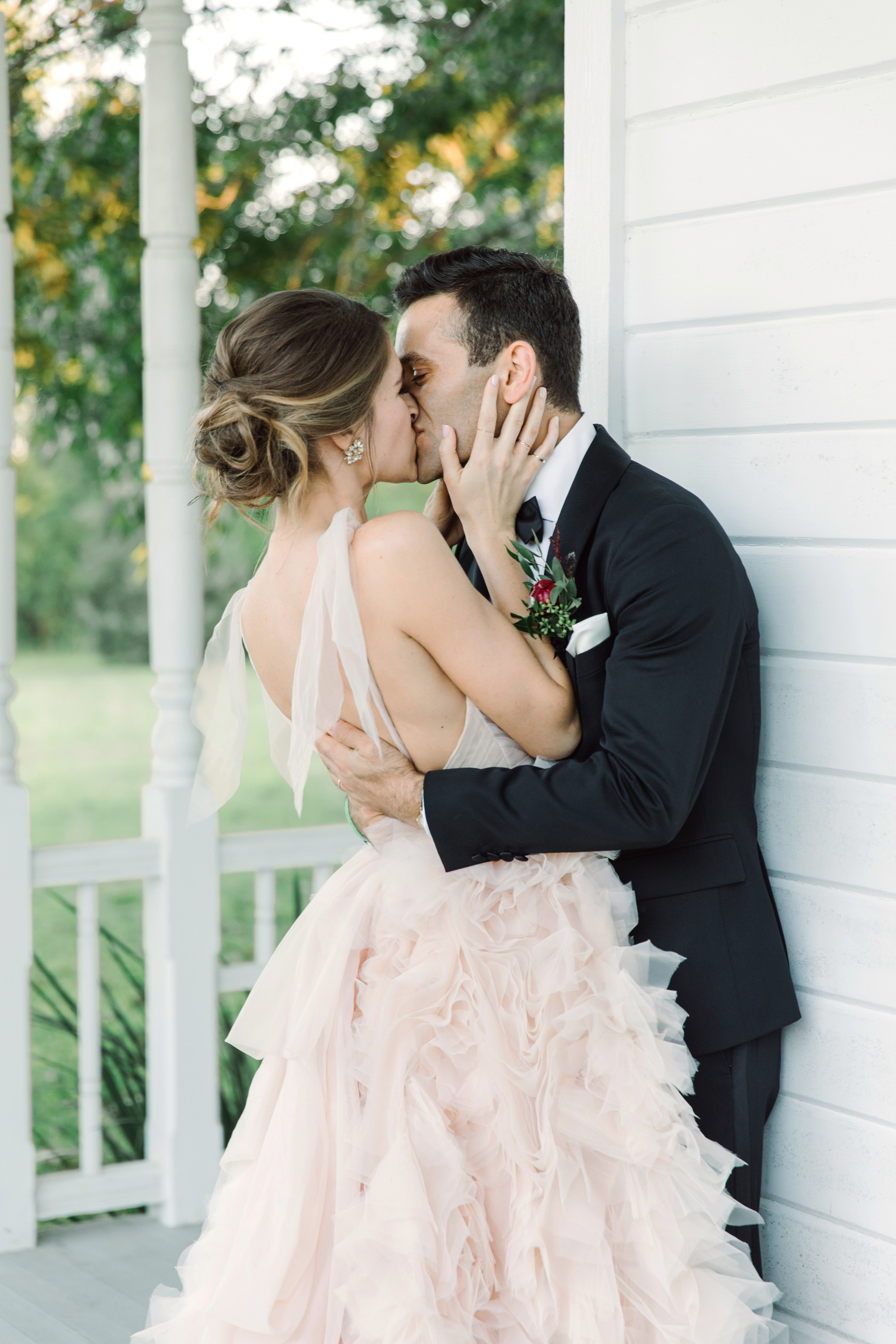 wedding couple kissing porch