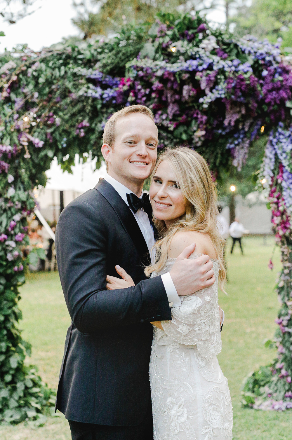 julia mitchell wedding couple embracing and smiling
