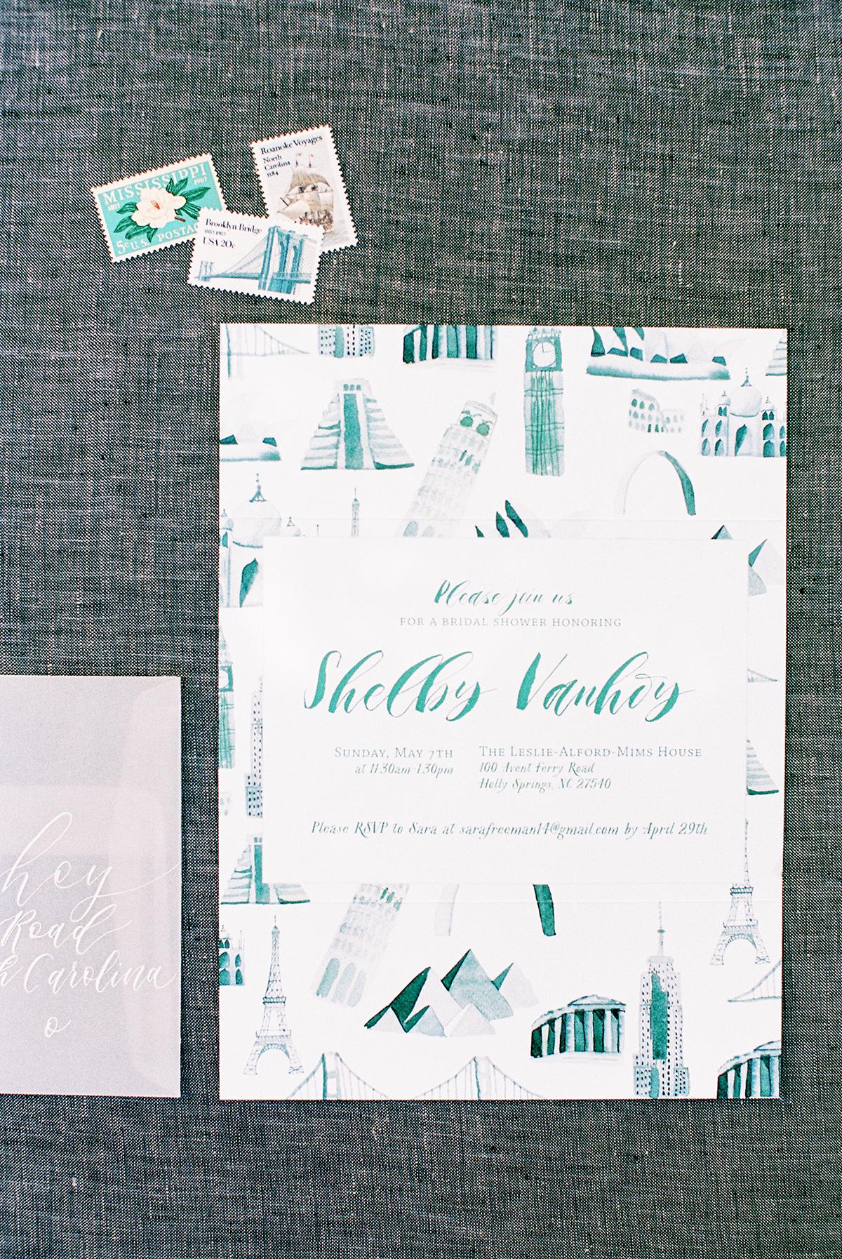 wedding invitation featuring different landmarks