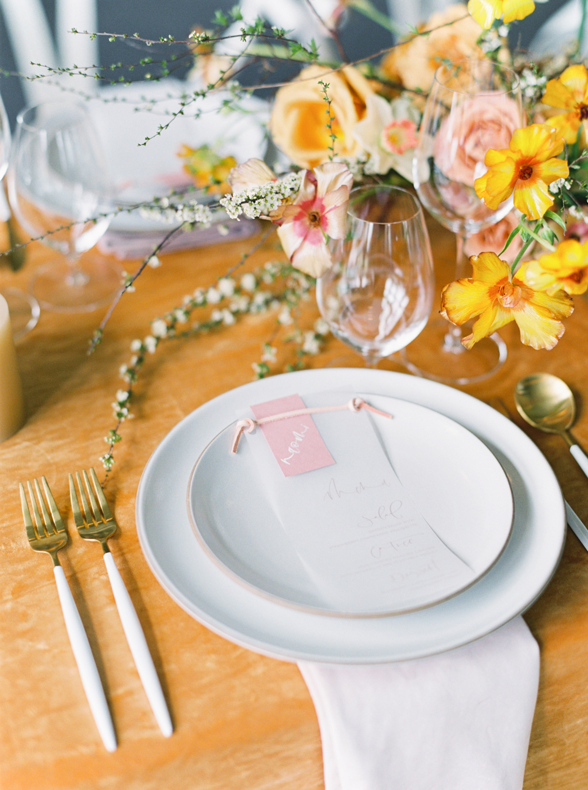 vellum menu with bright table setting