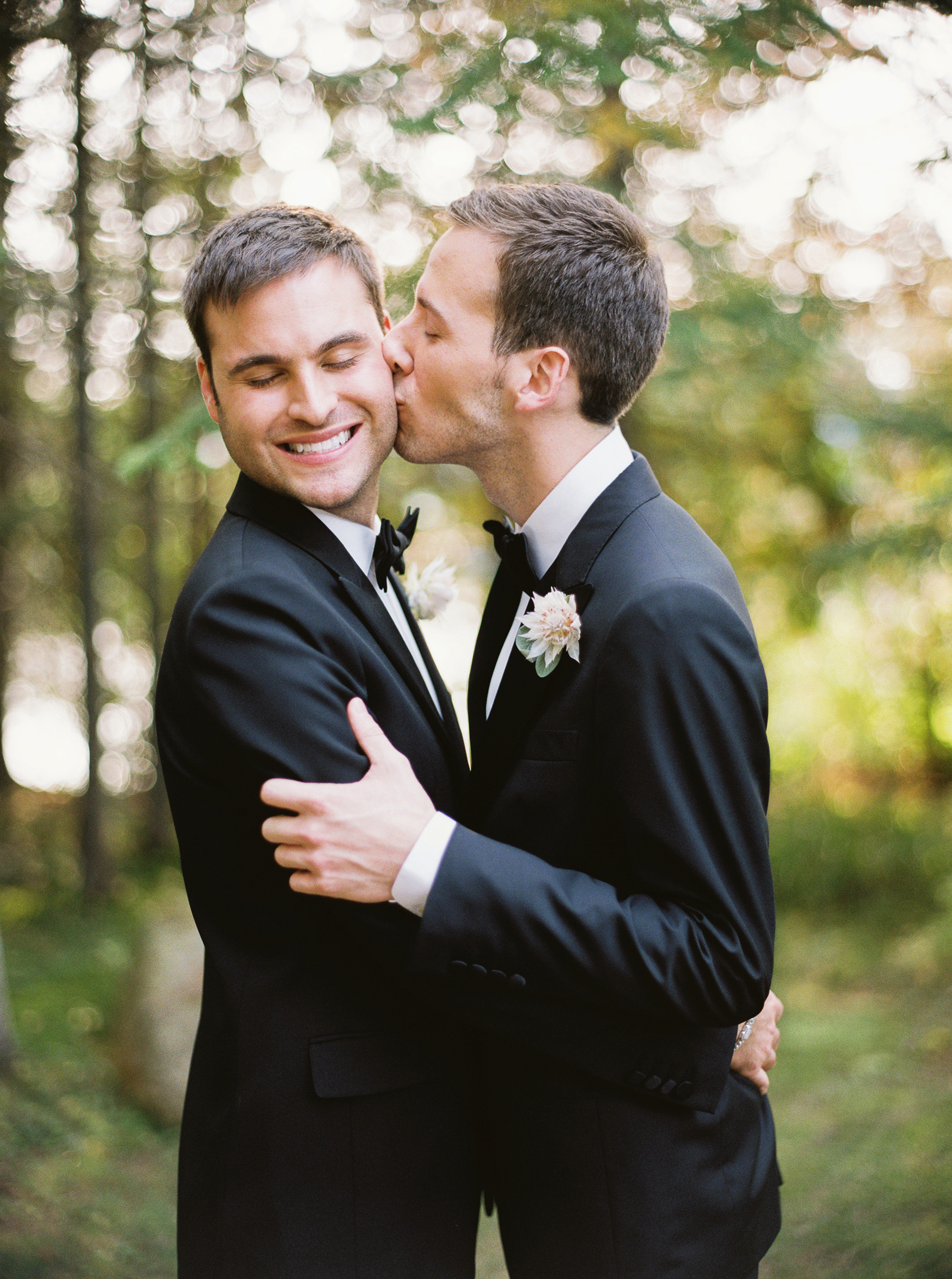 tory sean wedding lake placid new york couple kiss grooms