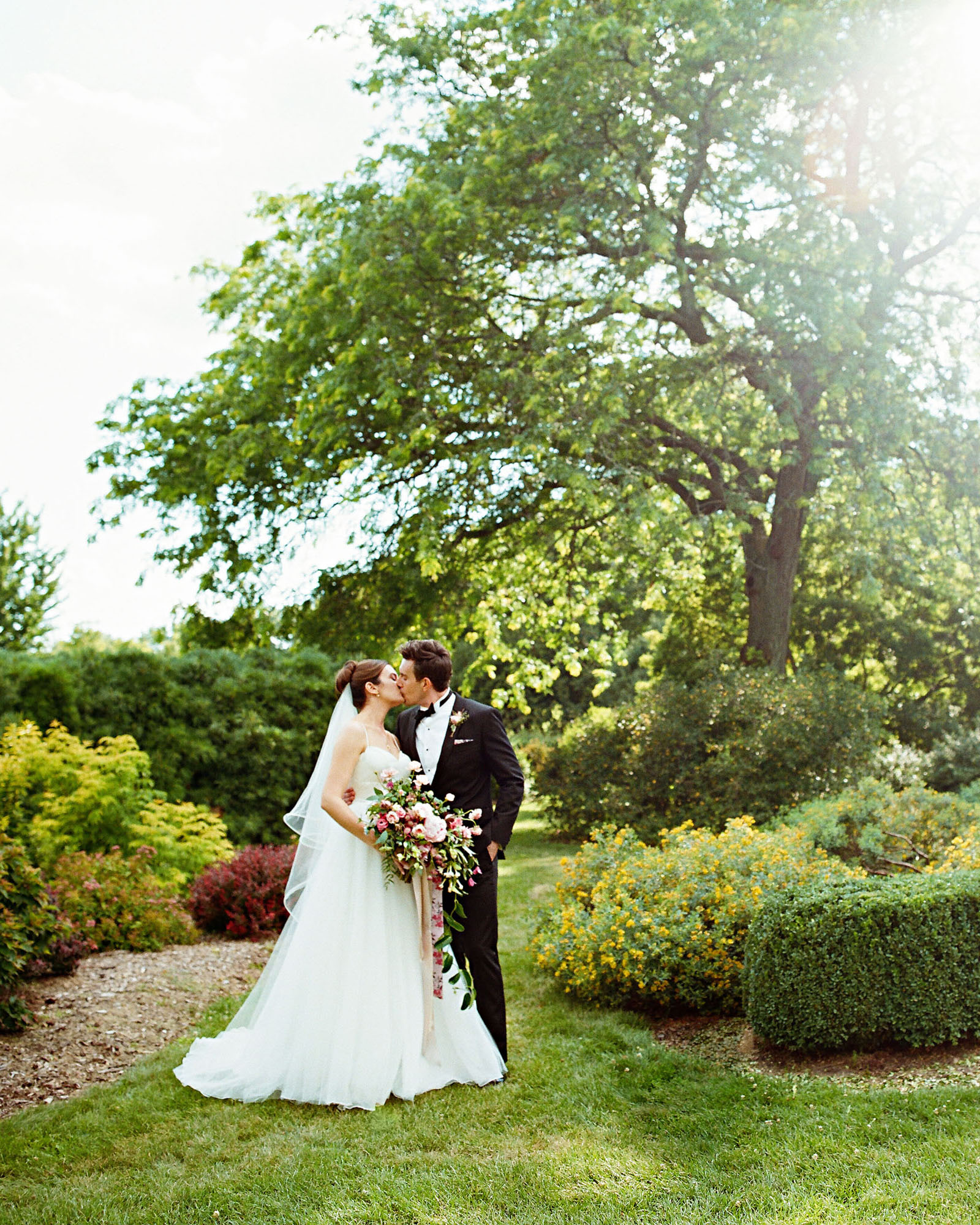 emer cooper wedding wisconsin couple kiss
