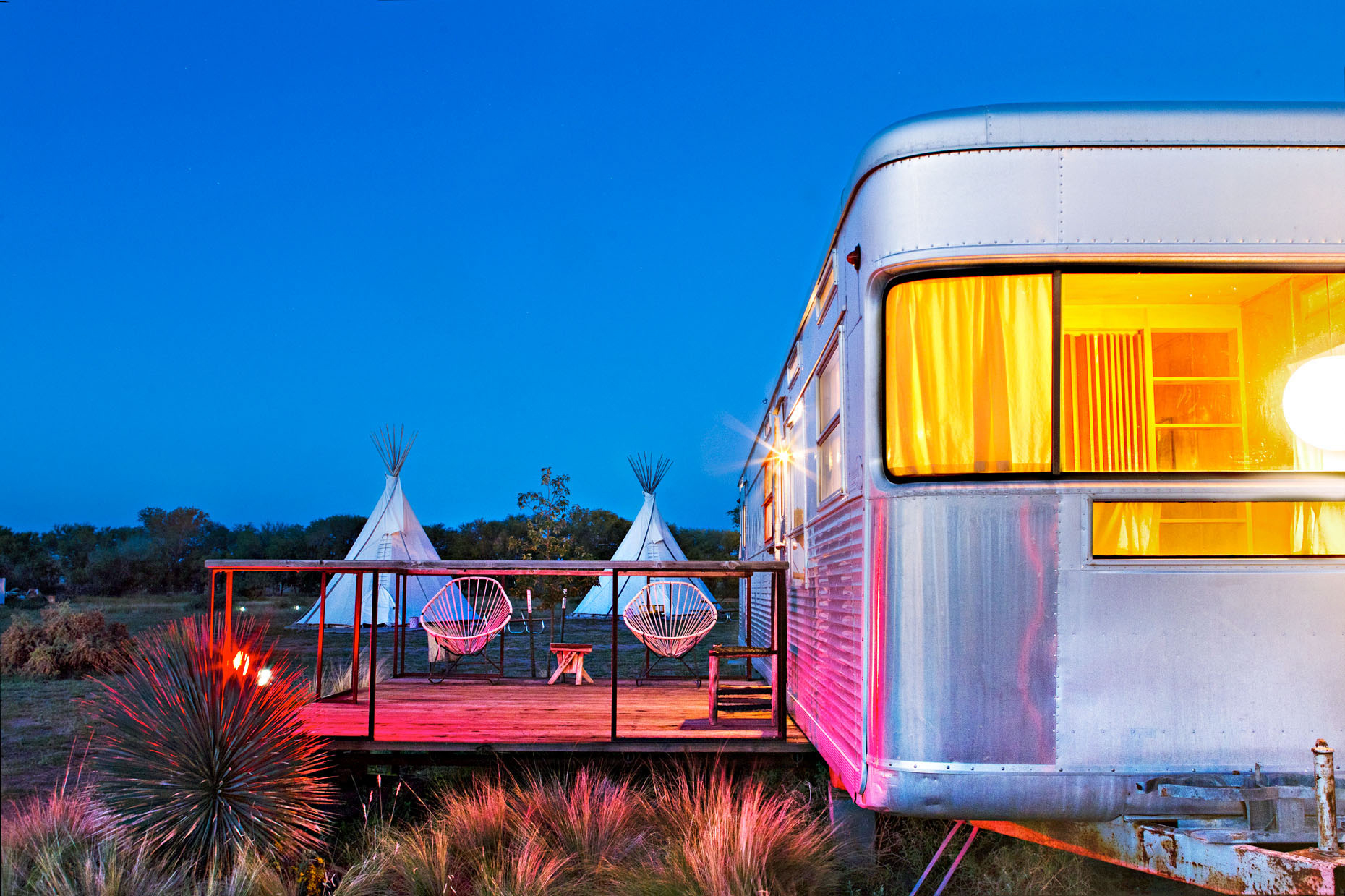 metal trailer with teepees in background