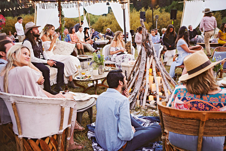 wedding guests rustic setting bon fire
