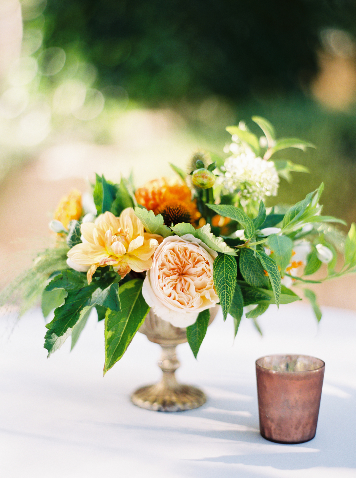 compote centerpieces small bouquet with orange flowers