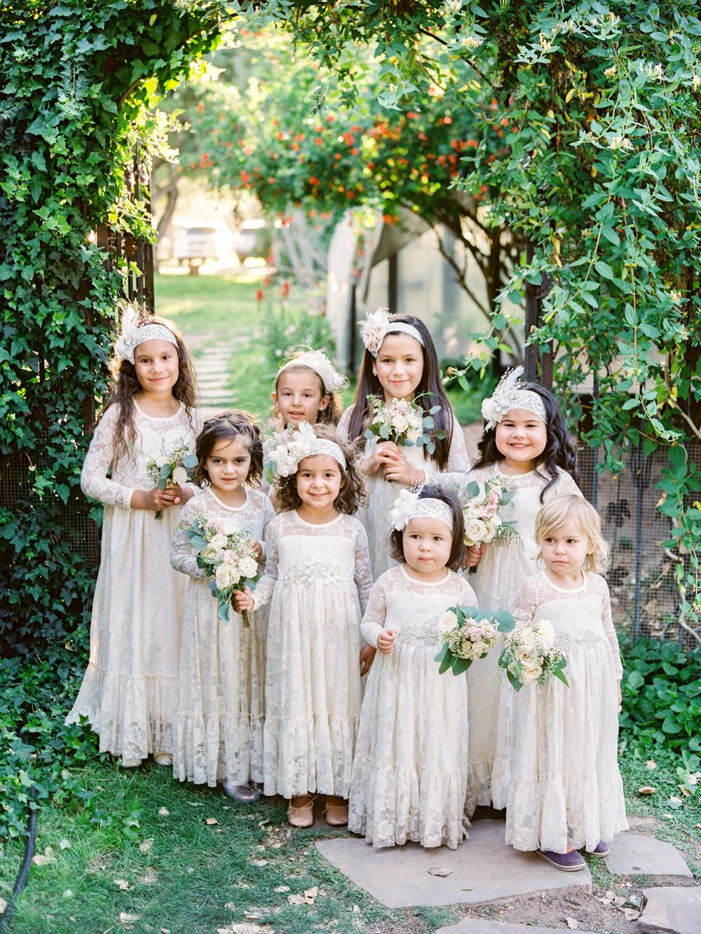 flower girls under arch