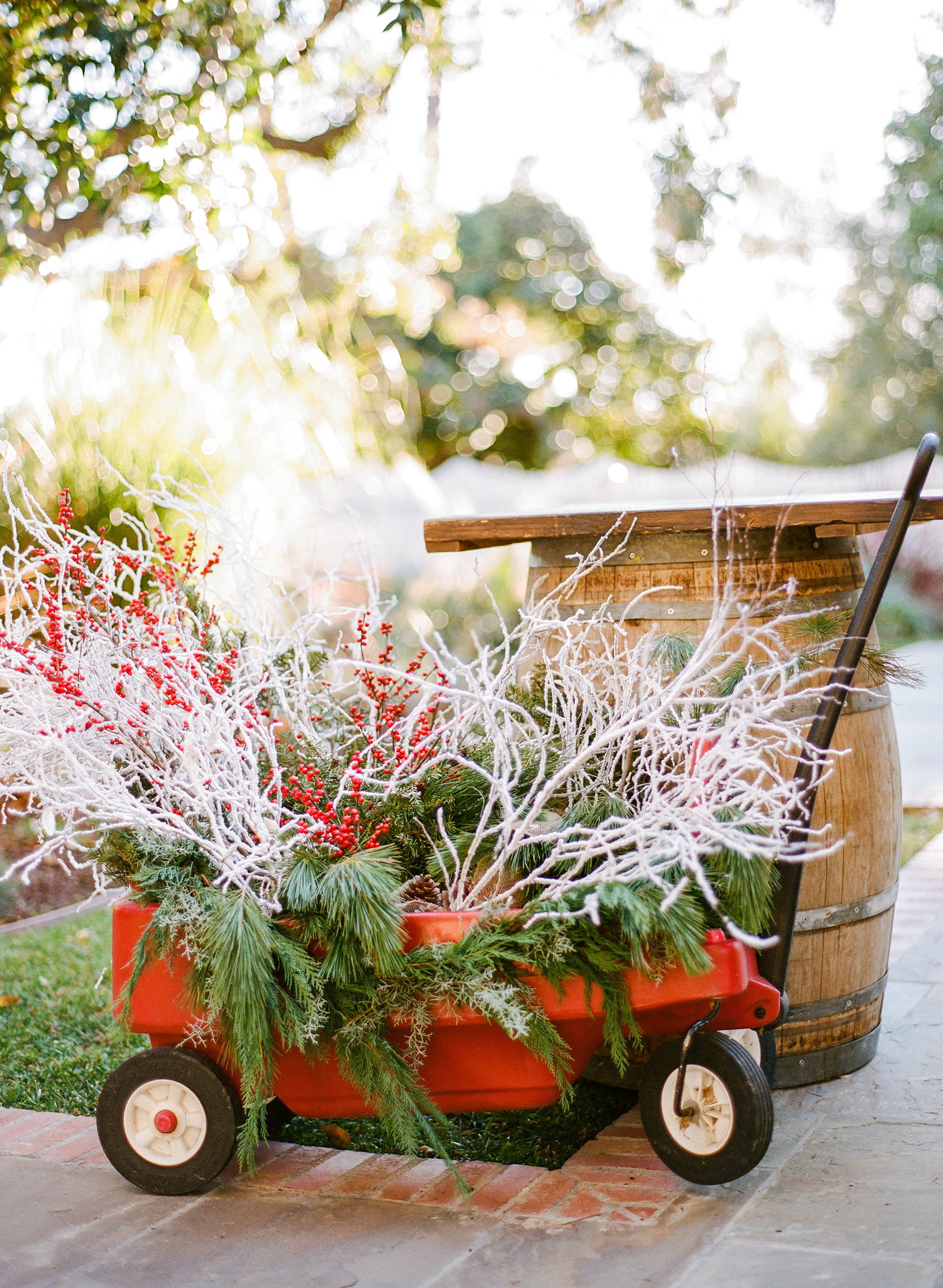 winter rehearsal dinner wagon with branches berries and evergreen