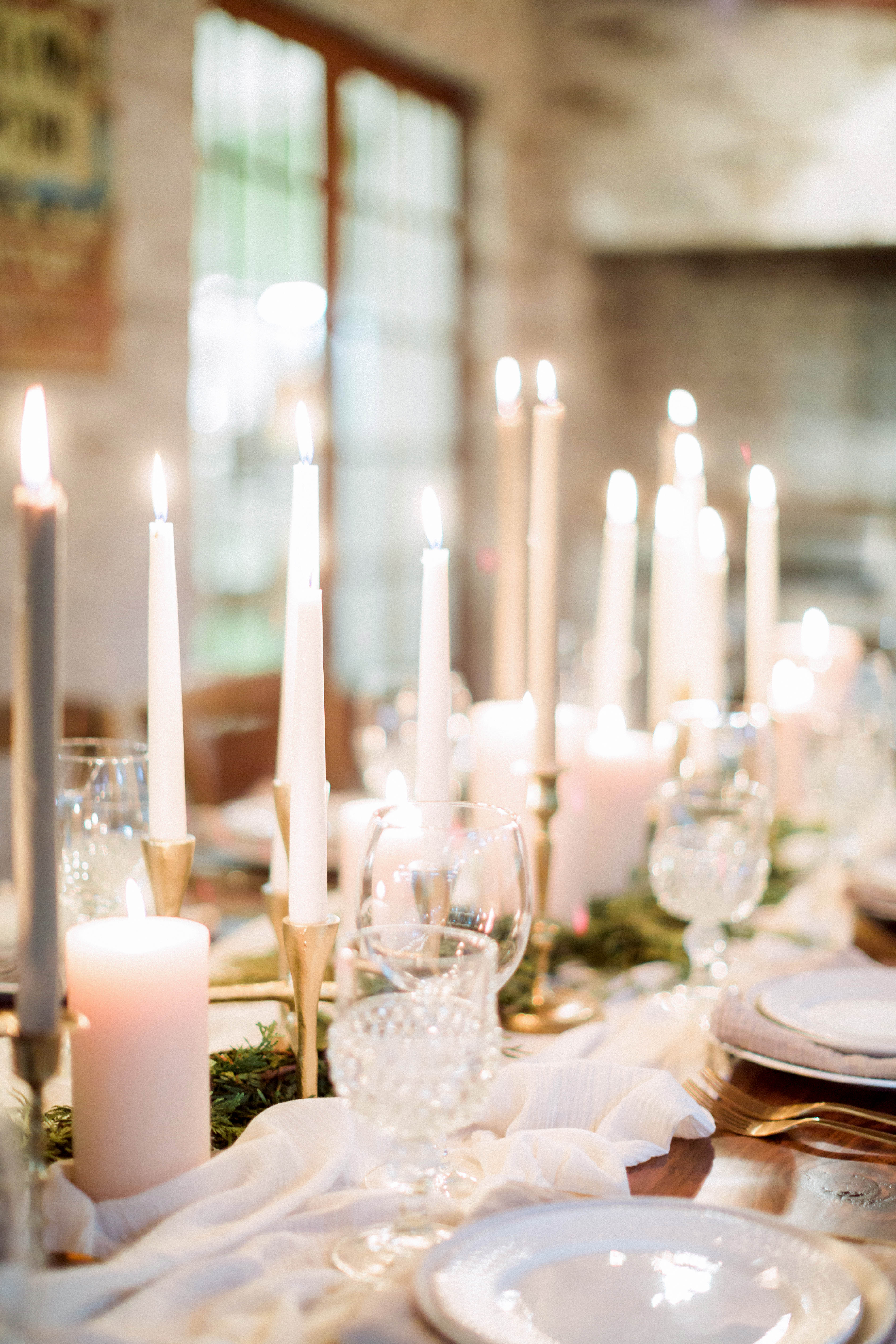 winter rehearsal dinner candle centerpieces table setting