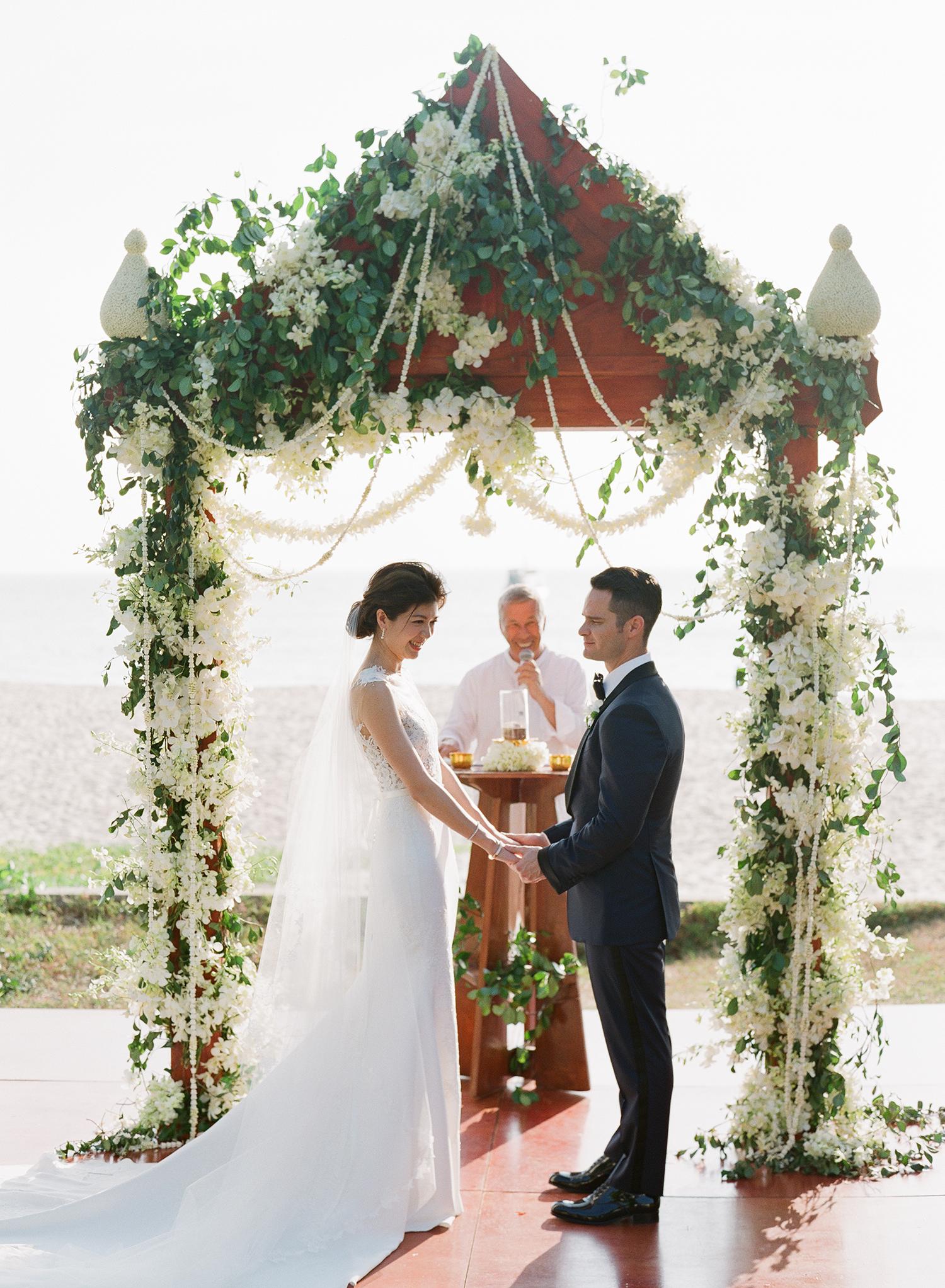 stacy brad wedding ceremony holding hands