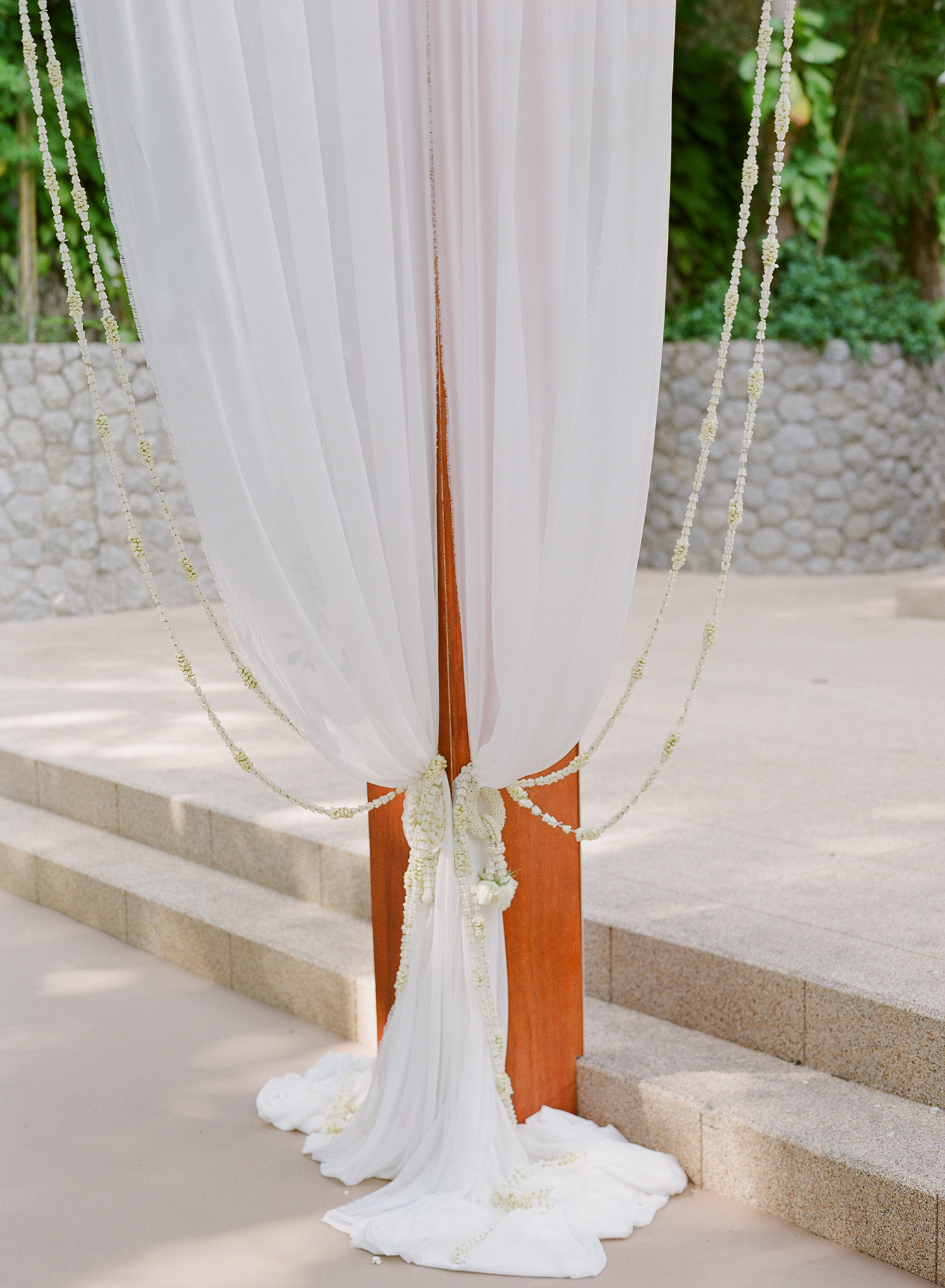 stacy brad wedding thailand draping on pole
