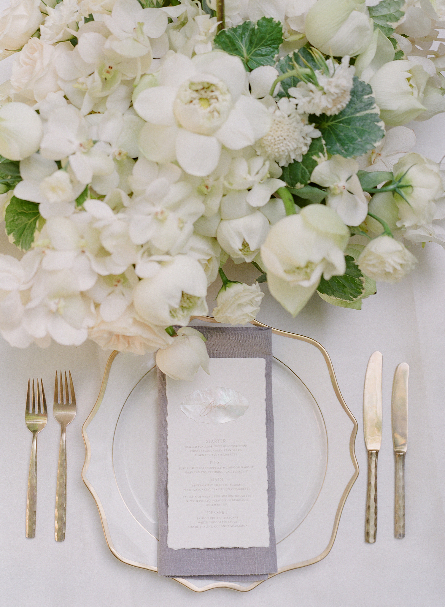 stacy brad wedding thailand plate setting with white flowers