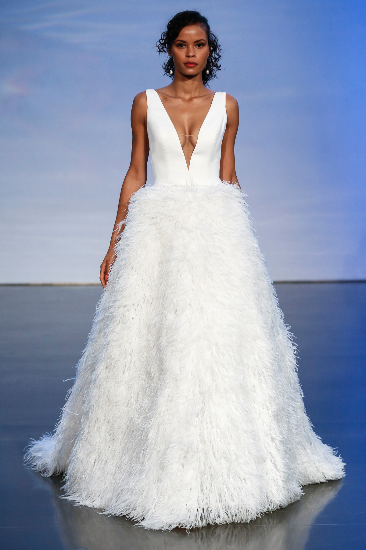 justin alexander signature fall 2019 deep v-neck ball gown with feathered skirt