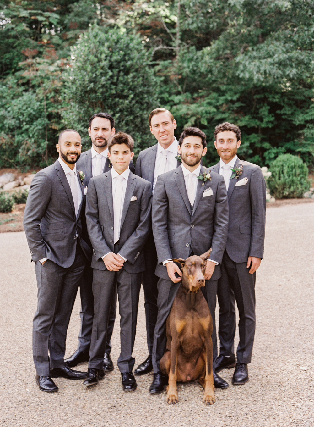 beth aaron wedding groomsmen with doberman