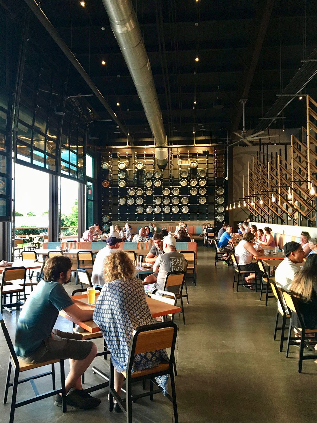 hawaii experience guests sitting at industrial brewing company