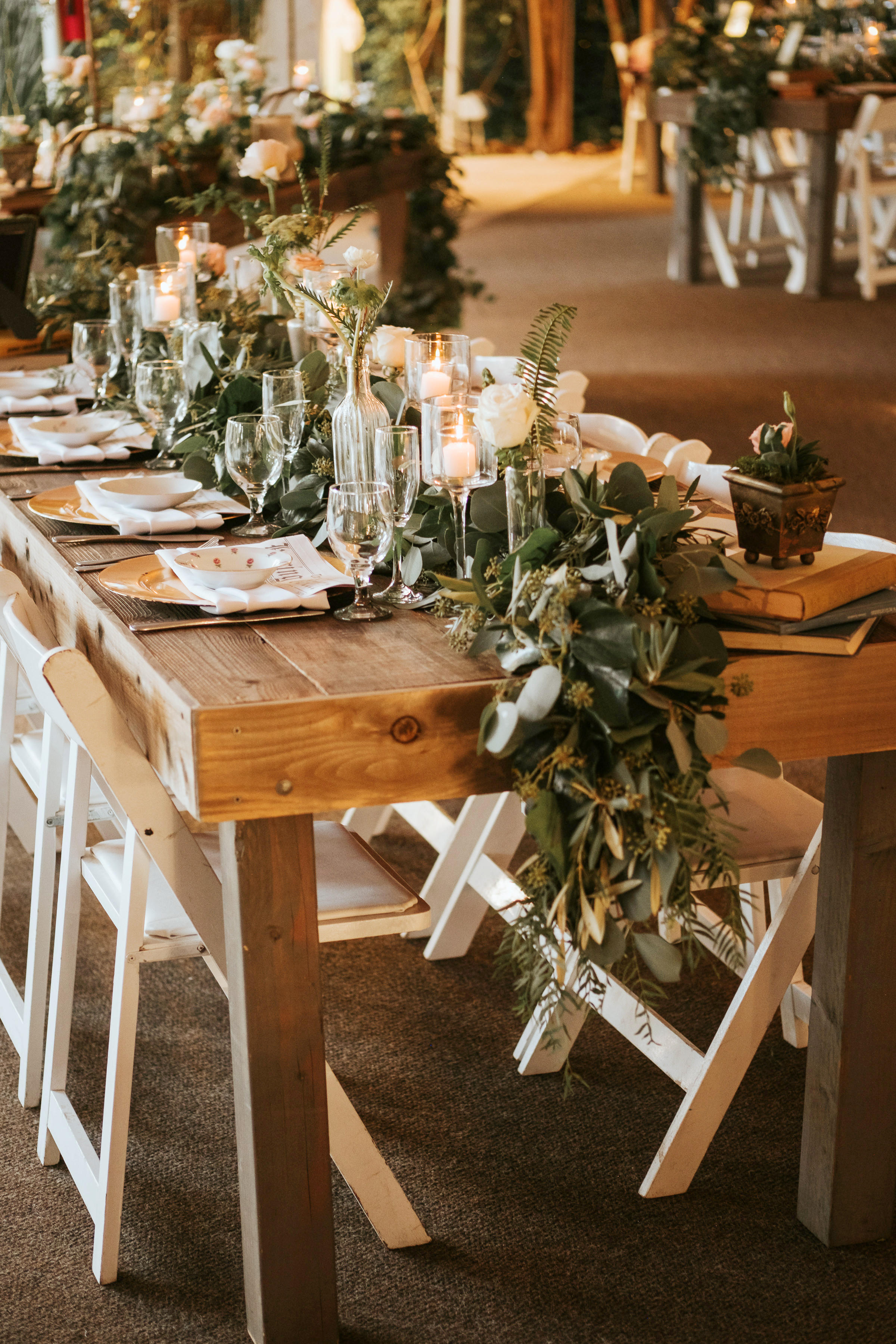 fall wedding centerpieces rustic wooden table greenery