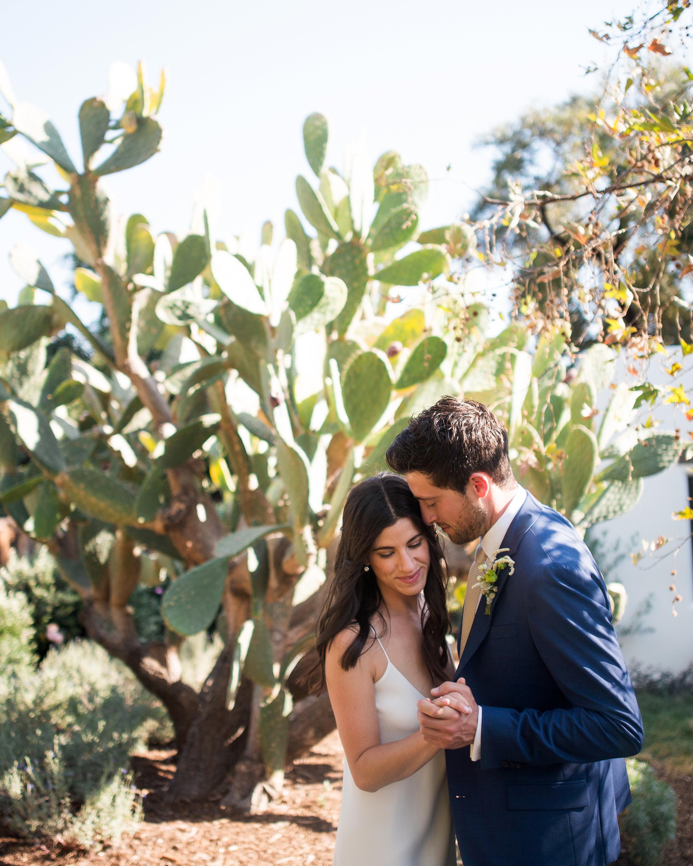 anika max wedding couple posing holding hands