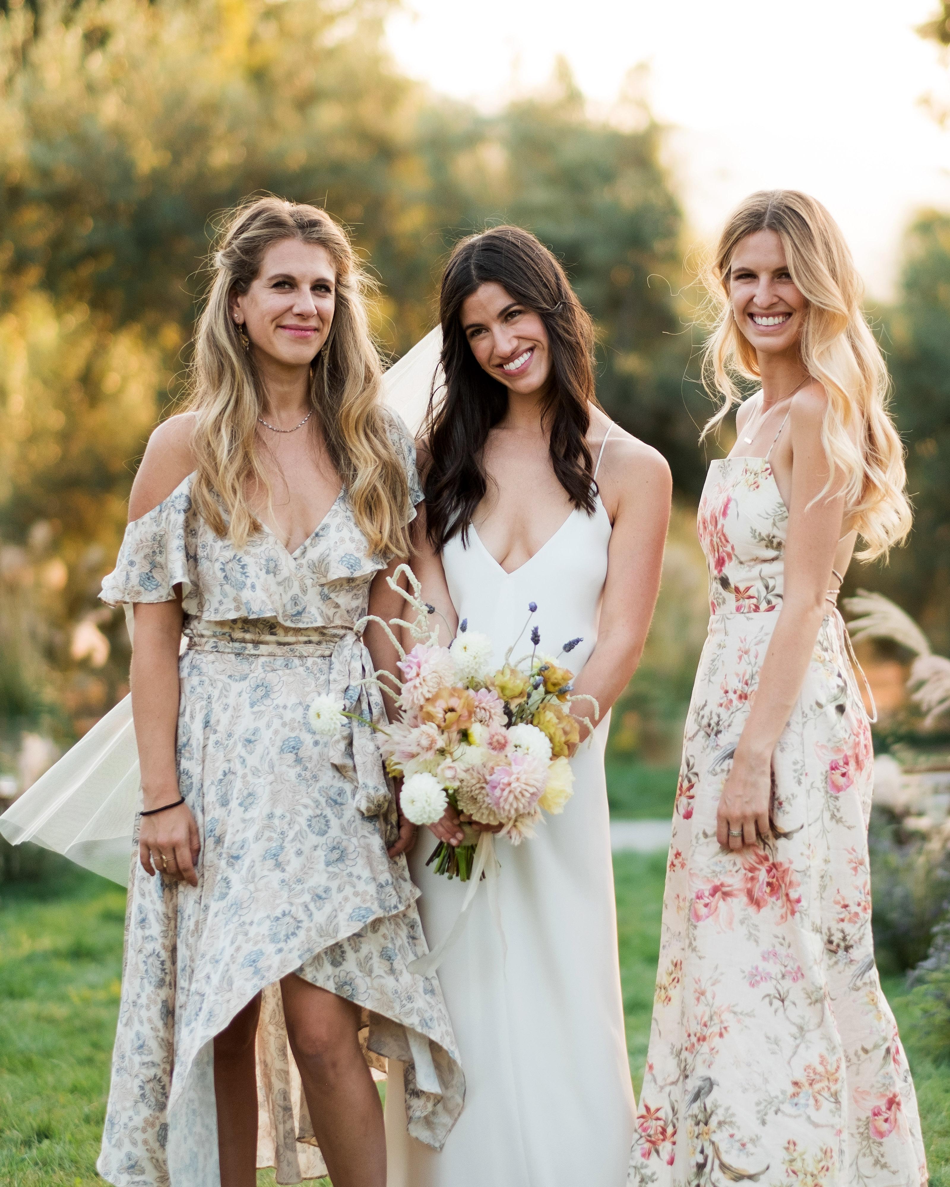anika max wedding bridesmaids wearing floral mismatched dresses