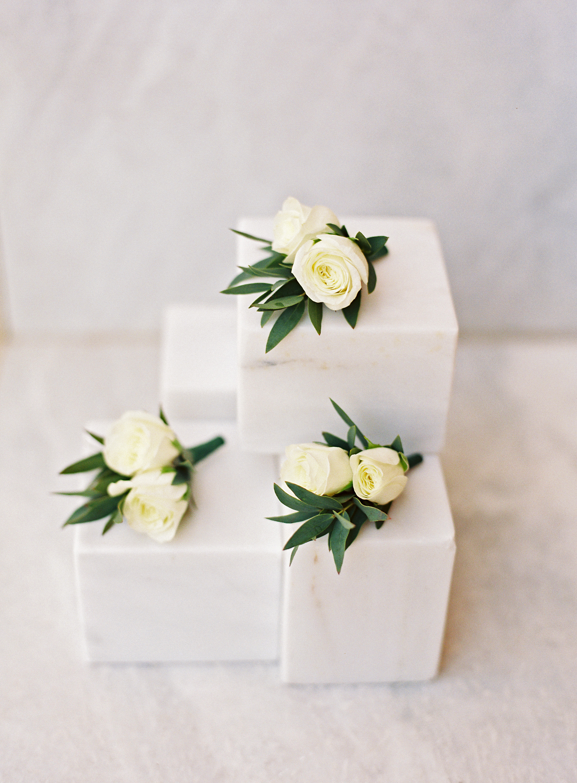 sze amanzoe wedding boutonnieres greece elegant
