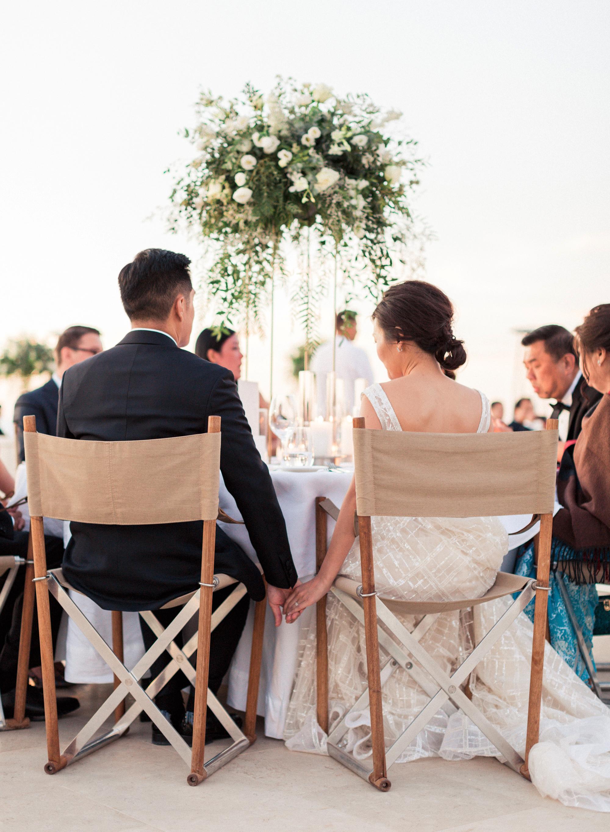 sze amanzoe wedding reception hands chairs greece elegant