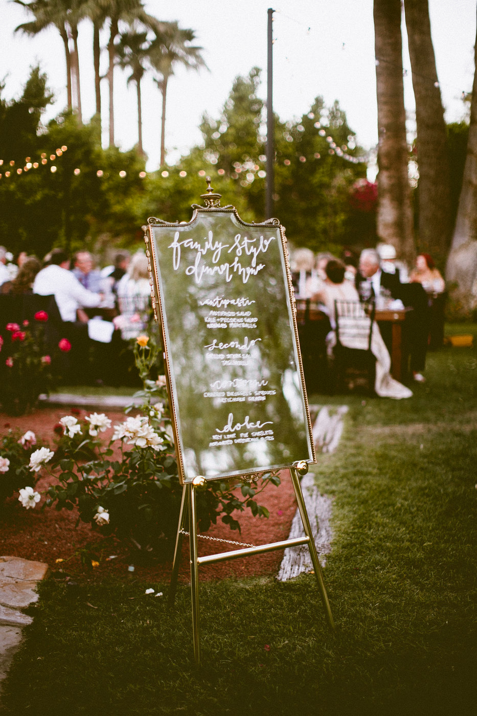 calligraphy dinner menu written on antique mirror