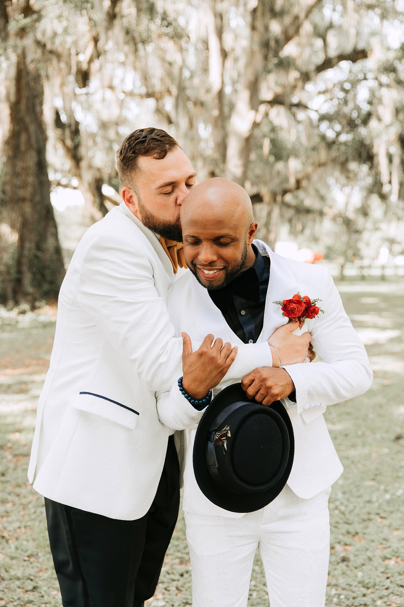 joe tim new orleans wedding grooms hugging