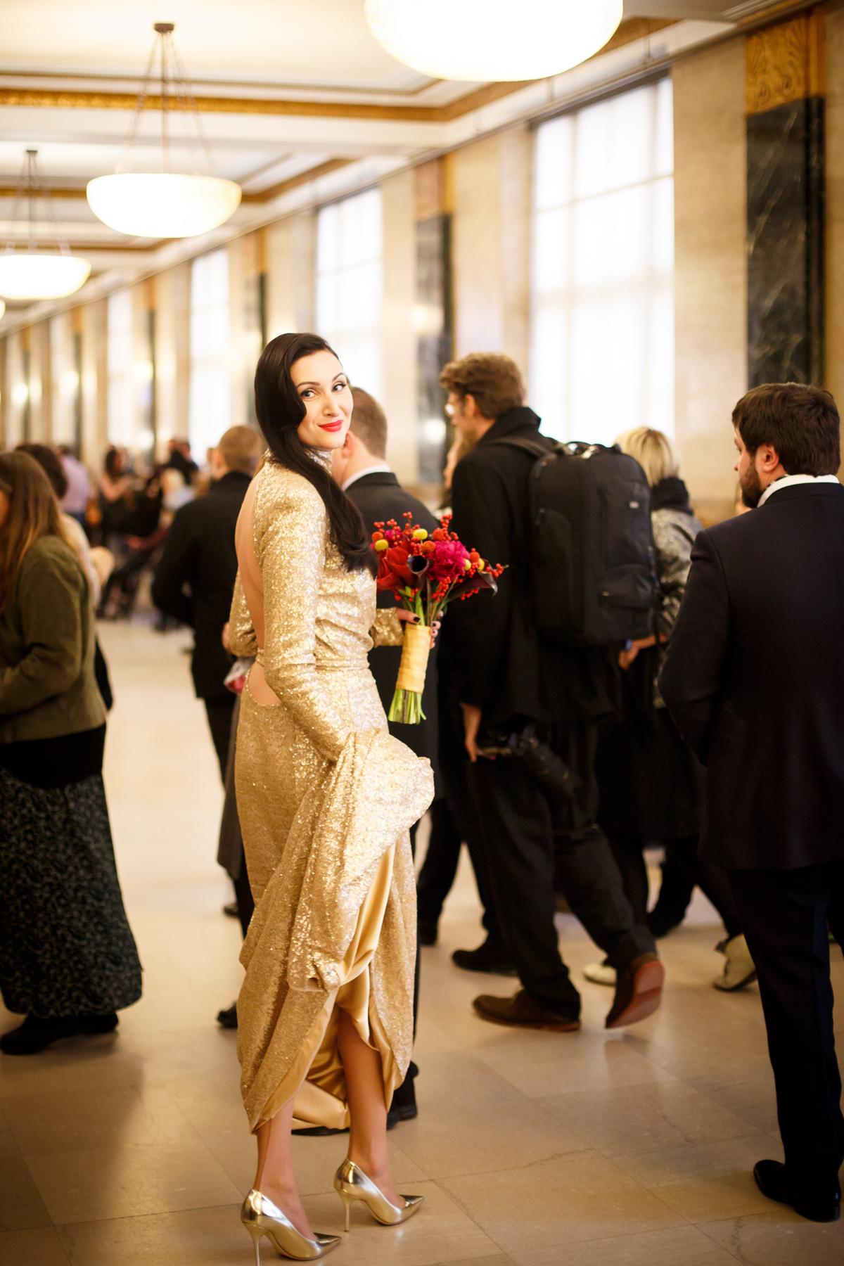 city hall wedding bride in golden dress with red bouquet