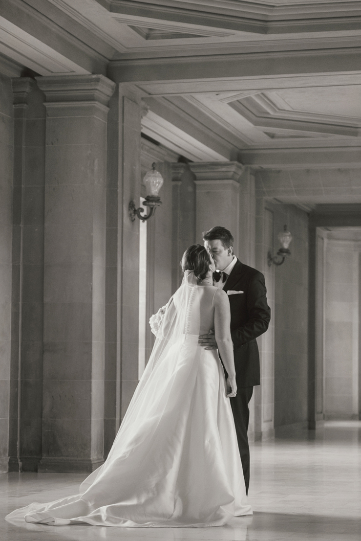 city hall wedding bride and groom kissing in hallway