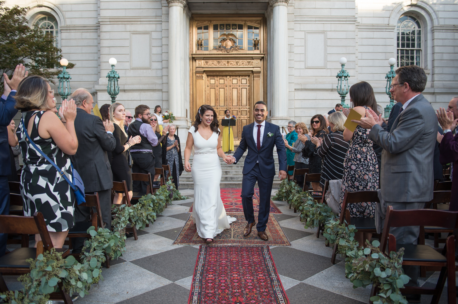 city hall wedding recessional bride and groom walking down path of rugs