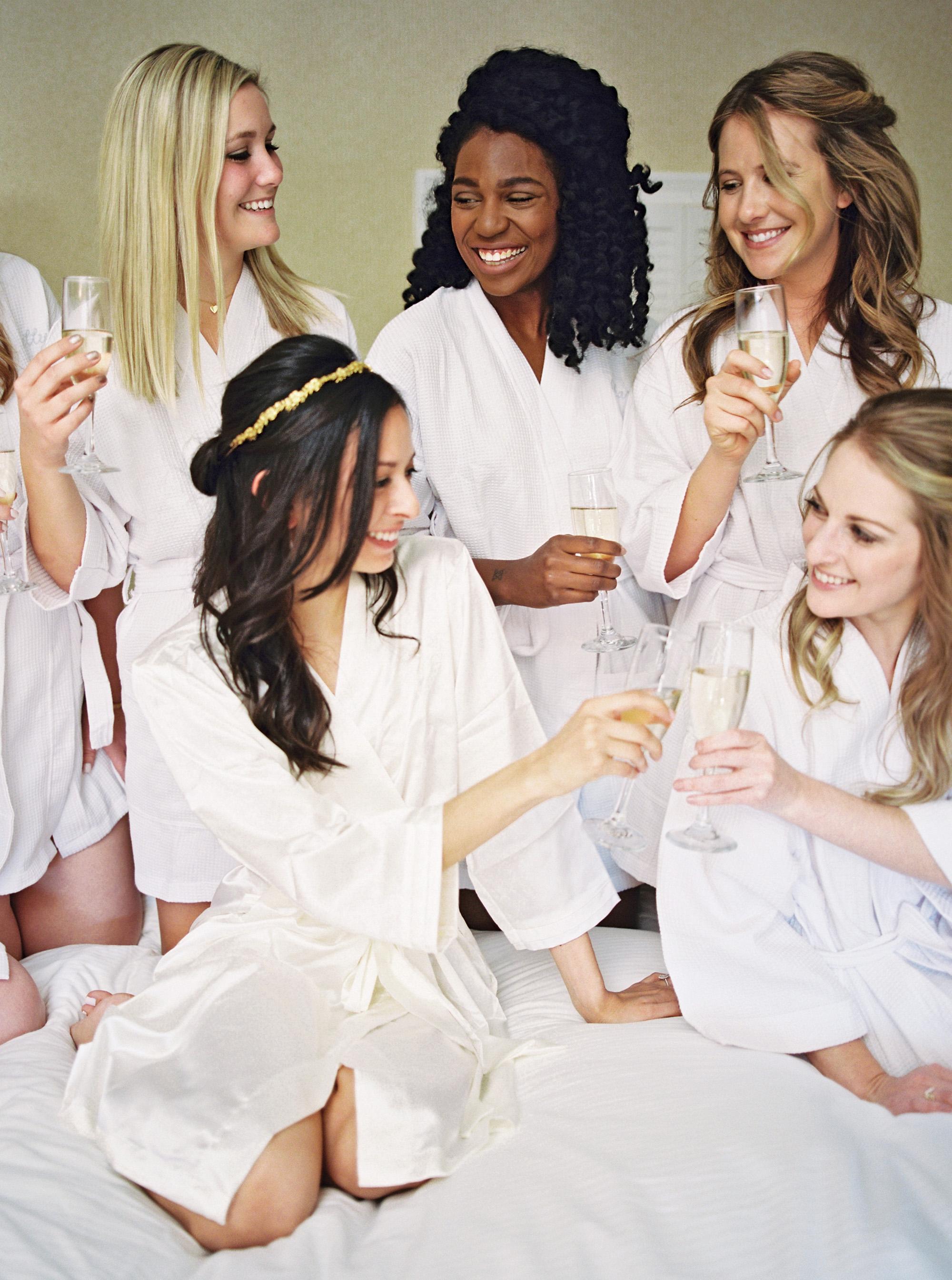 bridesmaids at spa drinking champagne