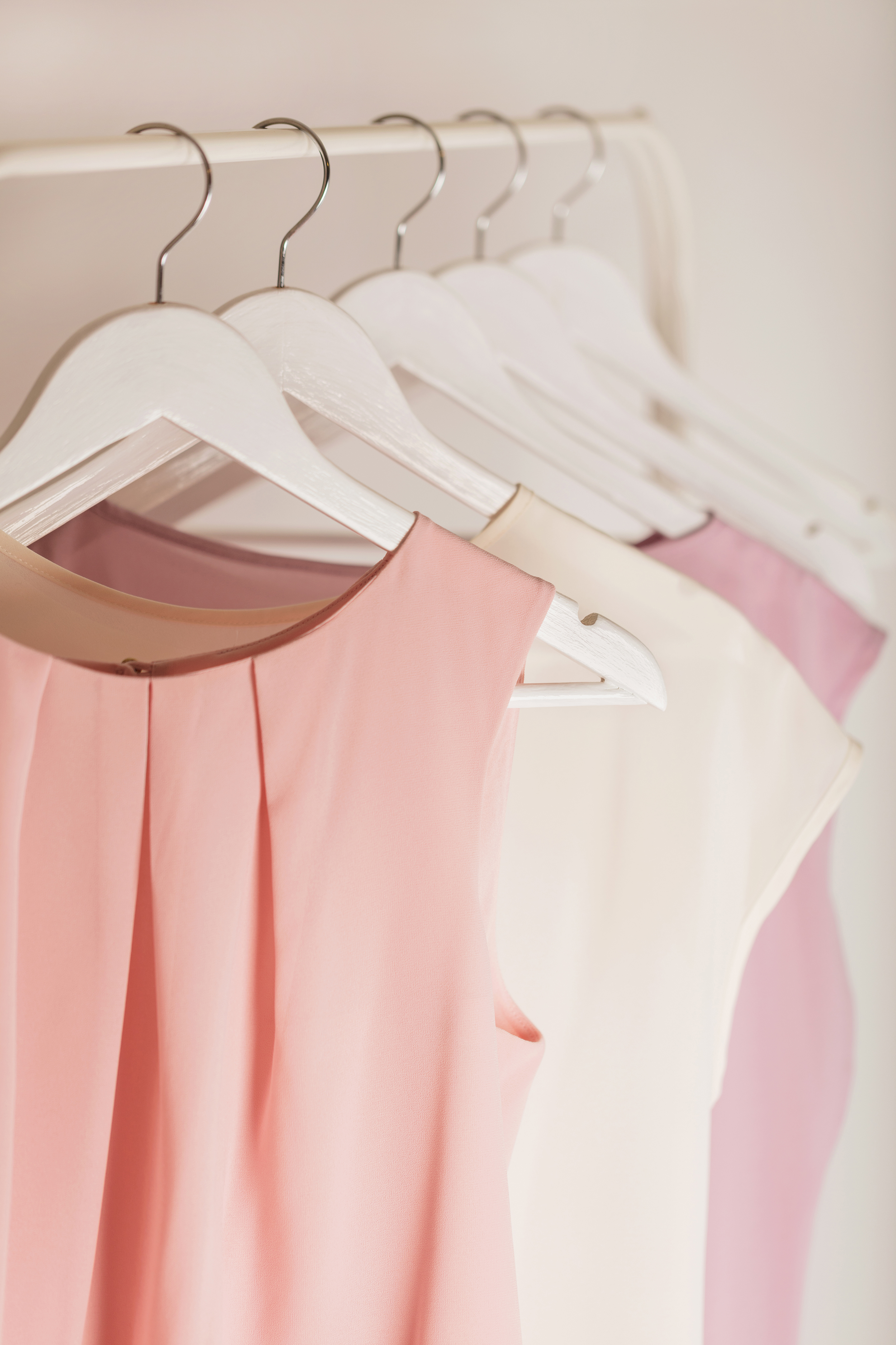 Plus-Size Shopping Tips for Mother of the Bride, Dresses Hanging on Rack