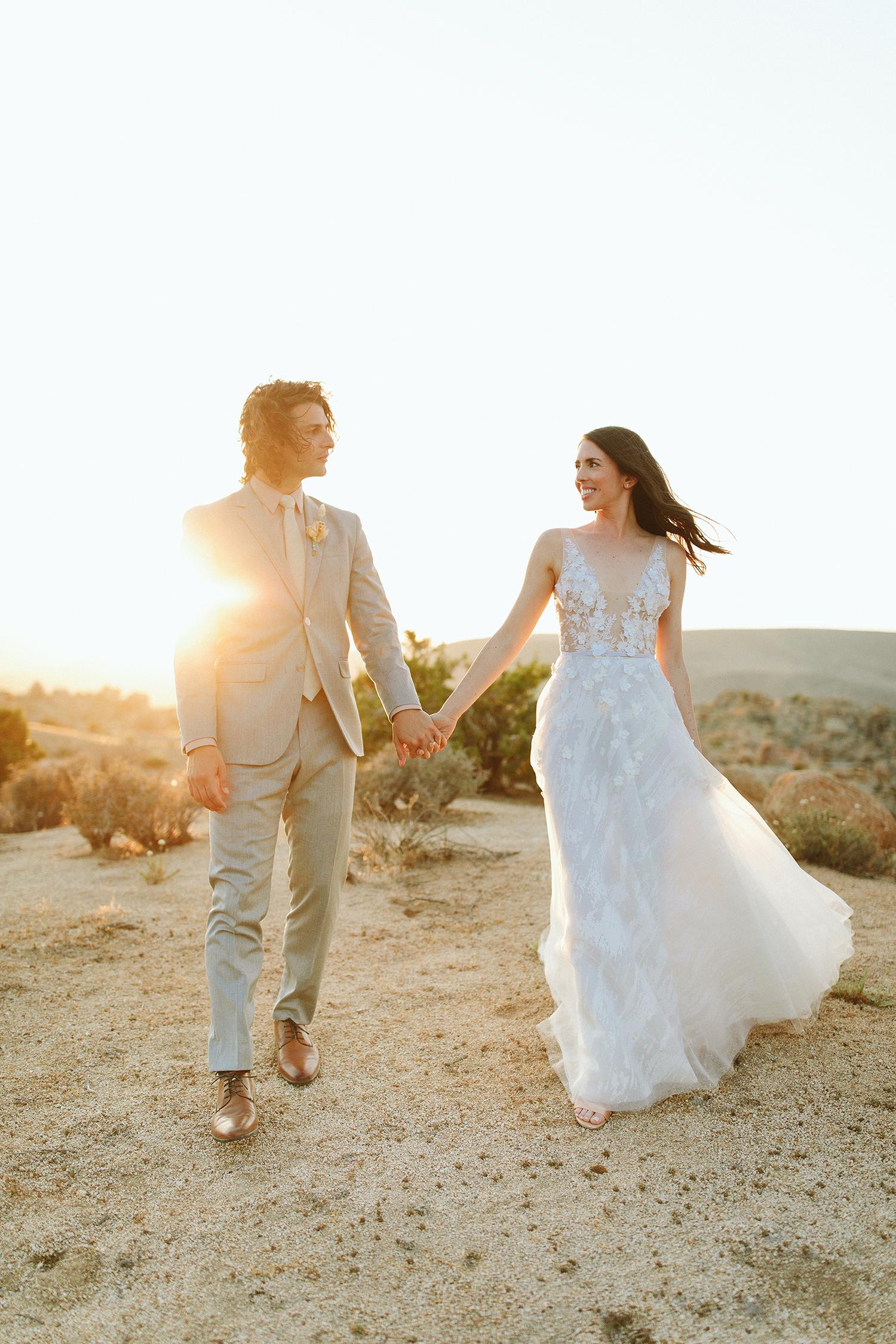 ashley basil wedding couple on desert at golden hour