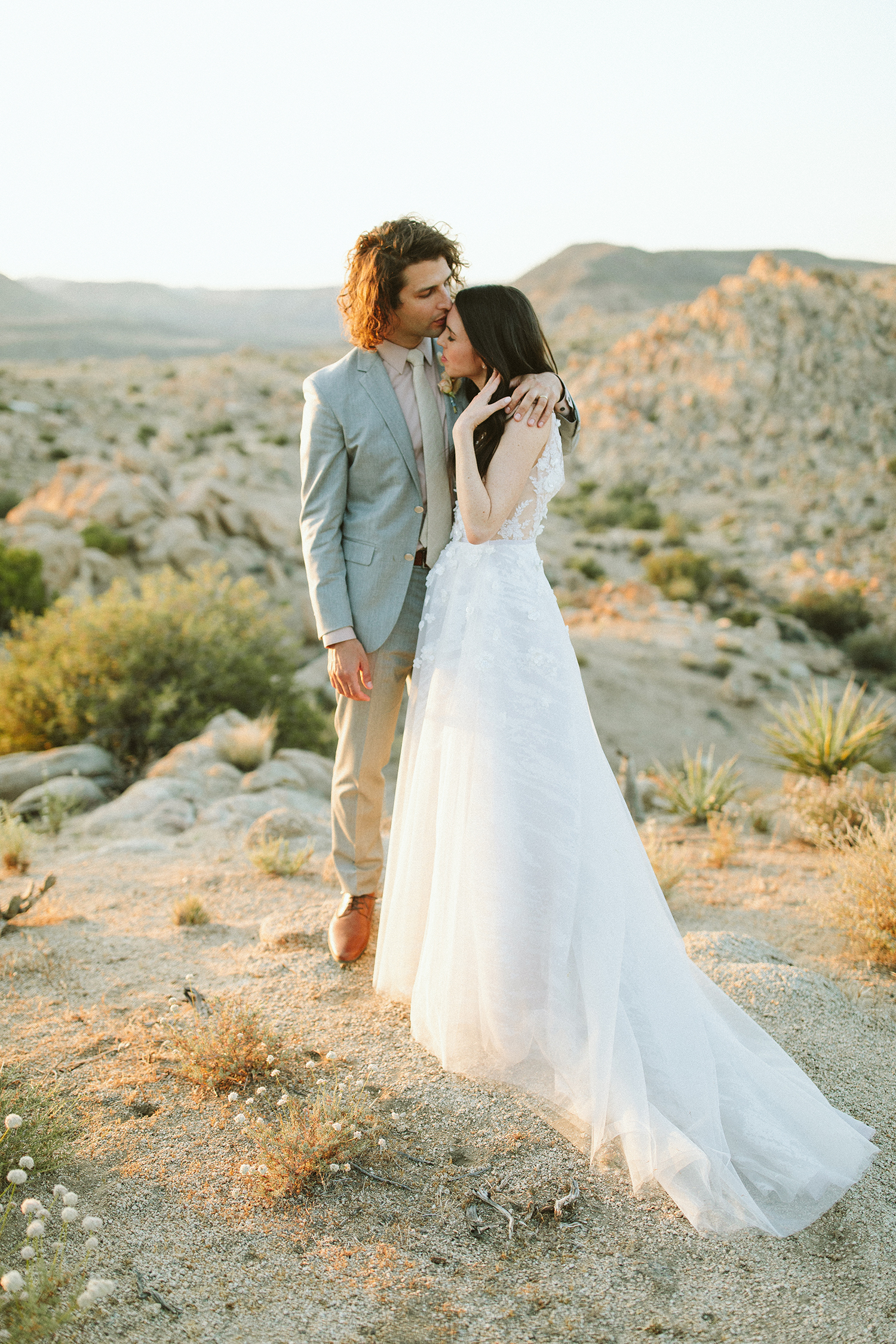 ashley basil wedding couple with desert hills