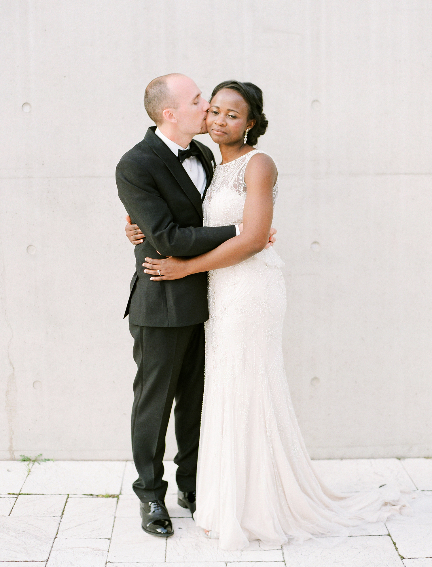 anwuli patrick wedding couple hugging in front of cream wall