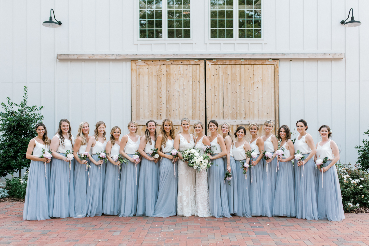 paige and kristine wedding brides with bridesmaids
