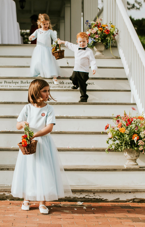 leah michael wedding flower girls ring bearer on stairs