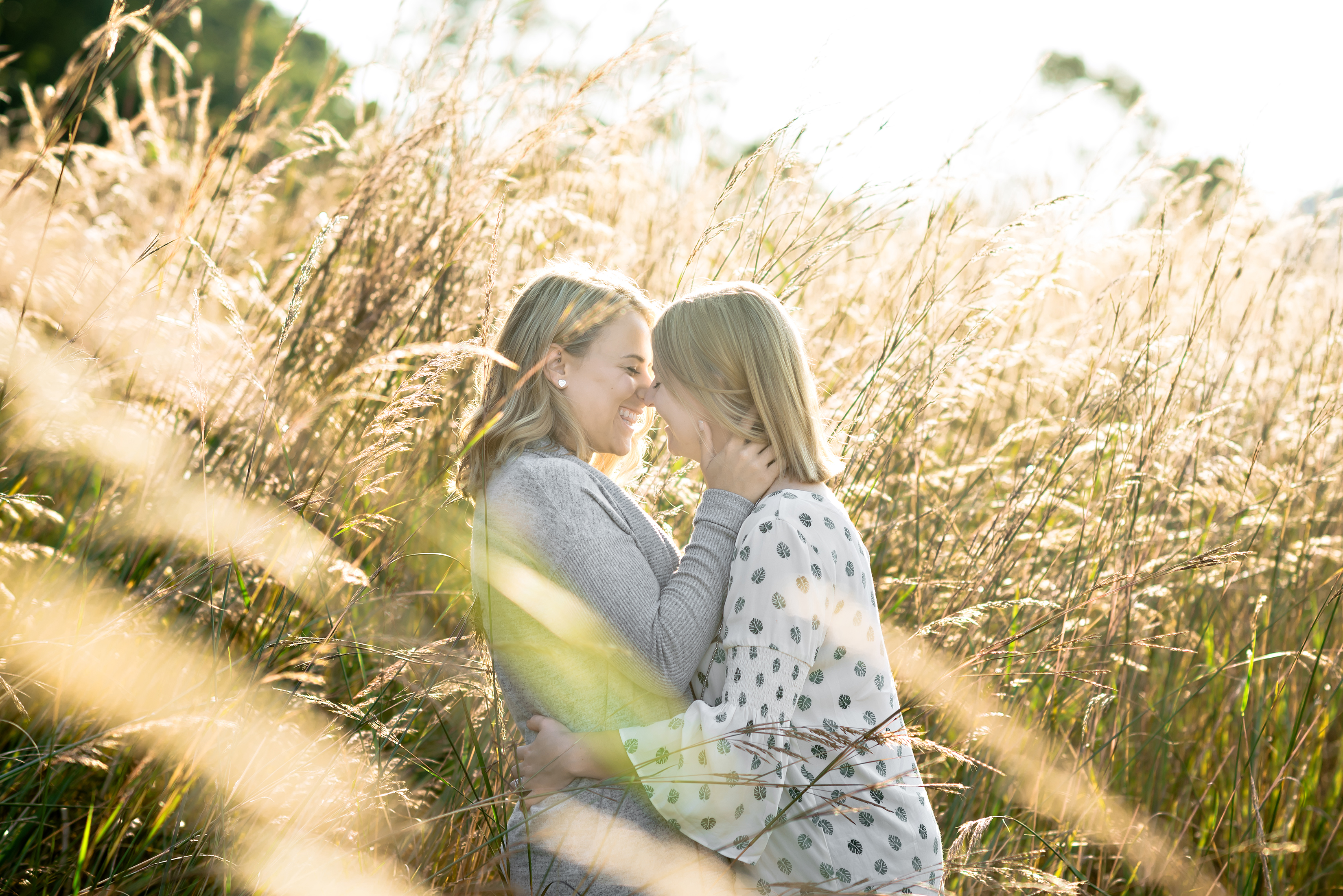 couple giggling in crops field engagement photo